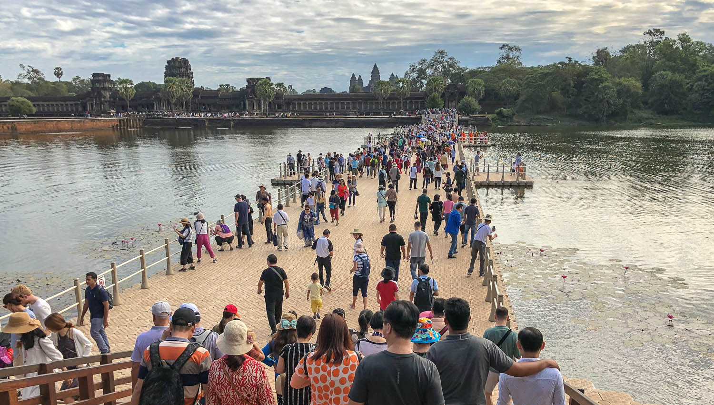 Crowds of tourists entering Angkor Wat. Image:  © Alan Williams