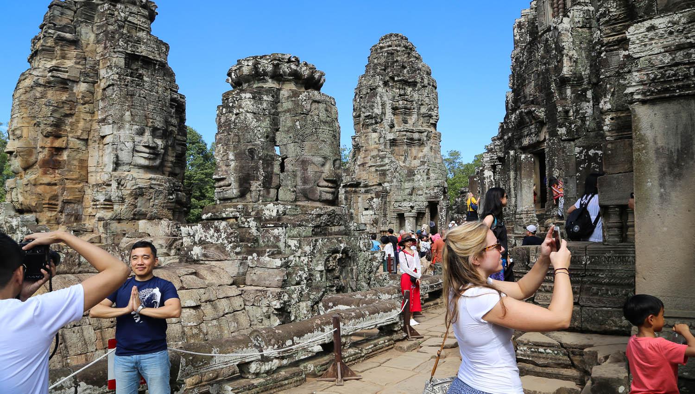 Visitors taking photographs at the Bayon temple. Image:  © Alan Williams