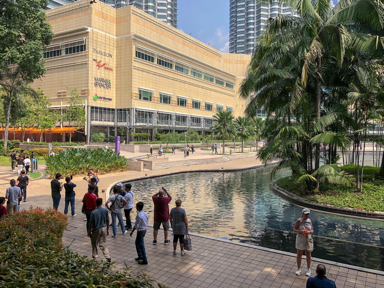 Tourists near the Suria KLCC shopping mall. Image:  © Alan Williams