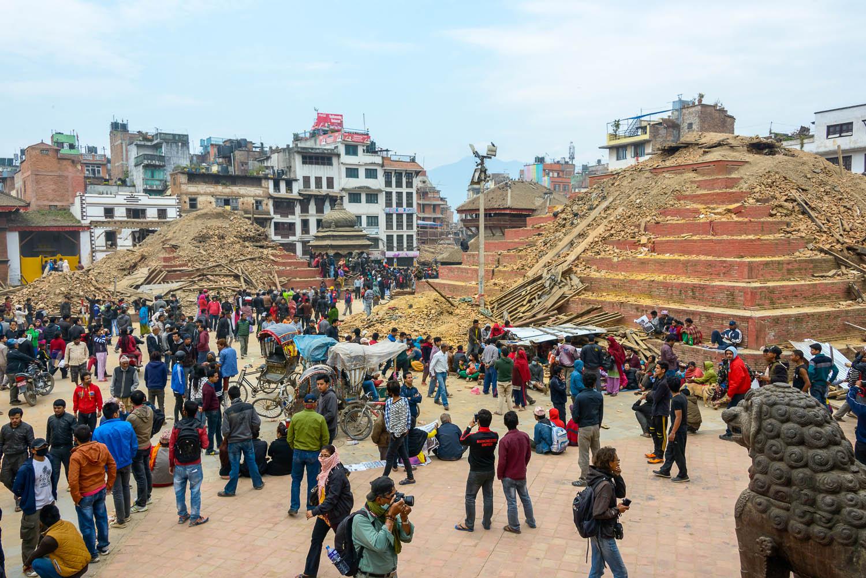 Visitors survey earthquake damage in Kathmandu in 2015. Image:  Thomas Dutour