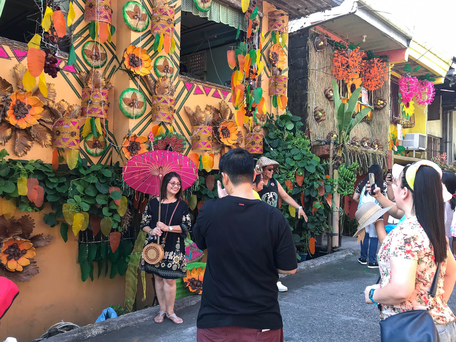 Tourists snap photos along the decorated streets. Image: © David Astley