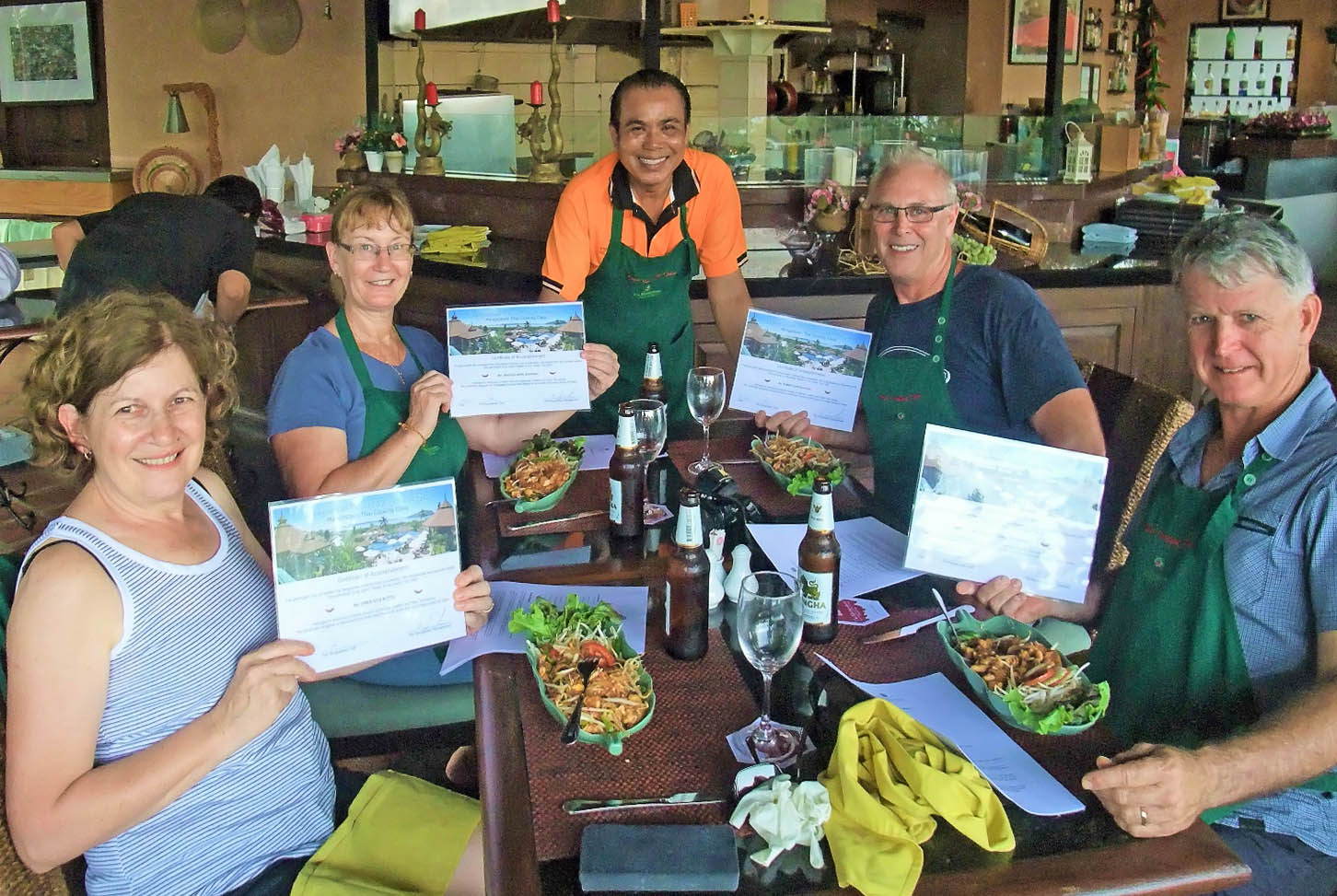 Guests with their Thai cooking class certificates at The Mangosteen.