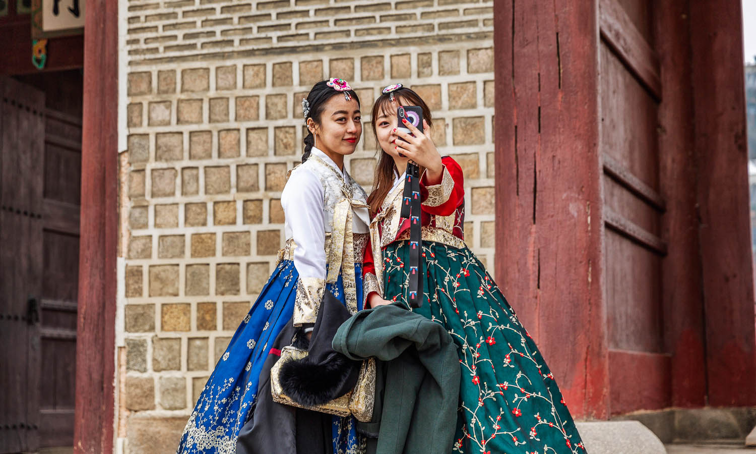 Young women in traditional dress on a Seoul street. Image:  © Anna Demidova