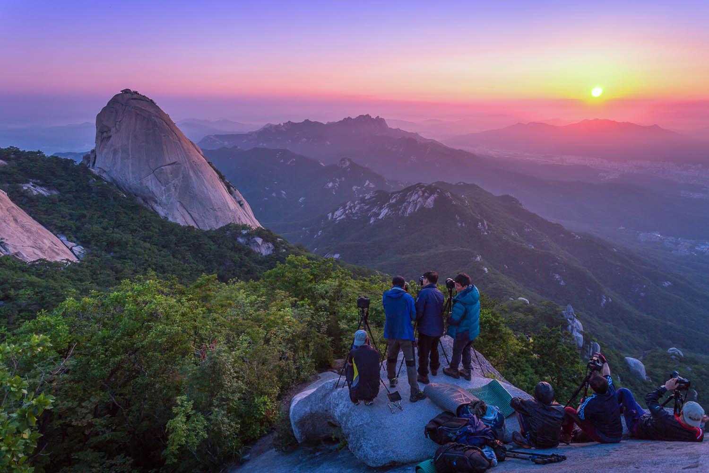 Photographers capturing a sunrise in South Korea. Image:  © Panya Khamtuy