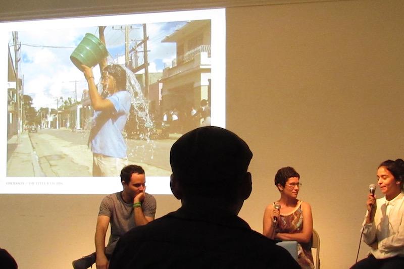 Elizabet Cerviño talks about  Chubasco , her public art performance done in 2006. At left, Jorge Wellesley; at center, curator María de Lourdes Mariño Fernández, who interviewed Cerviño.  Photo: Cuban Art News