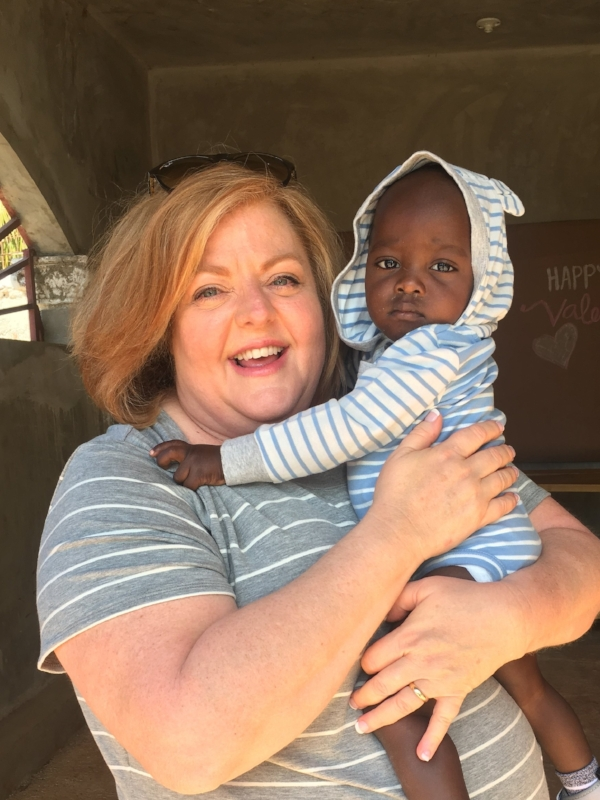 Mrs. Beth holding one of the cutest members of the Potter & Clay family, LoLo.