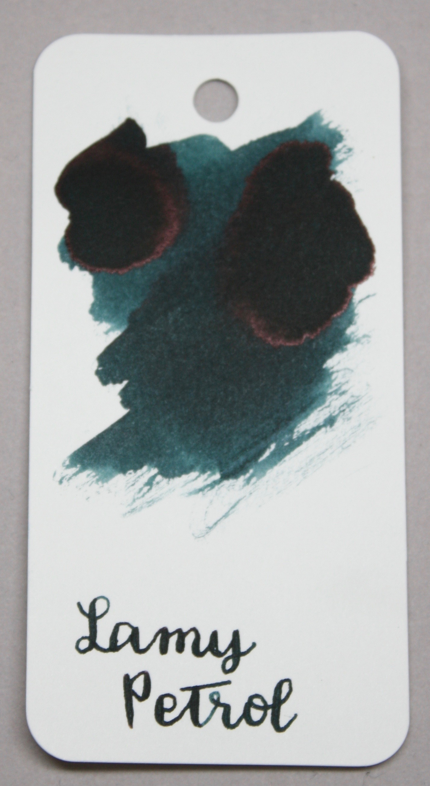 The color... - The ink is dark, not quite navy color when concentrated. When used with smaller nibs, it looks more of a dark teal. This swab was done on the Col-o-ring by Skylab Letterpress.