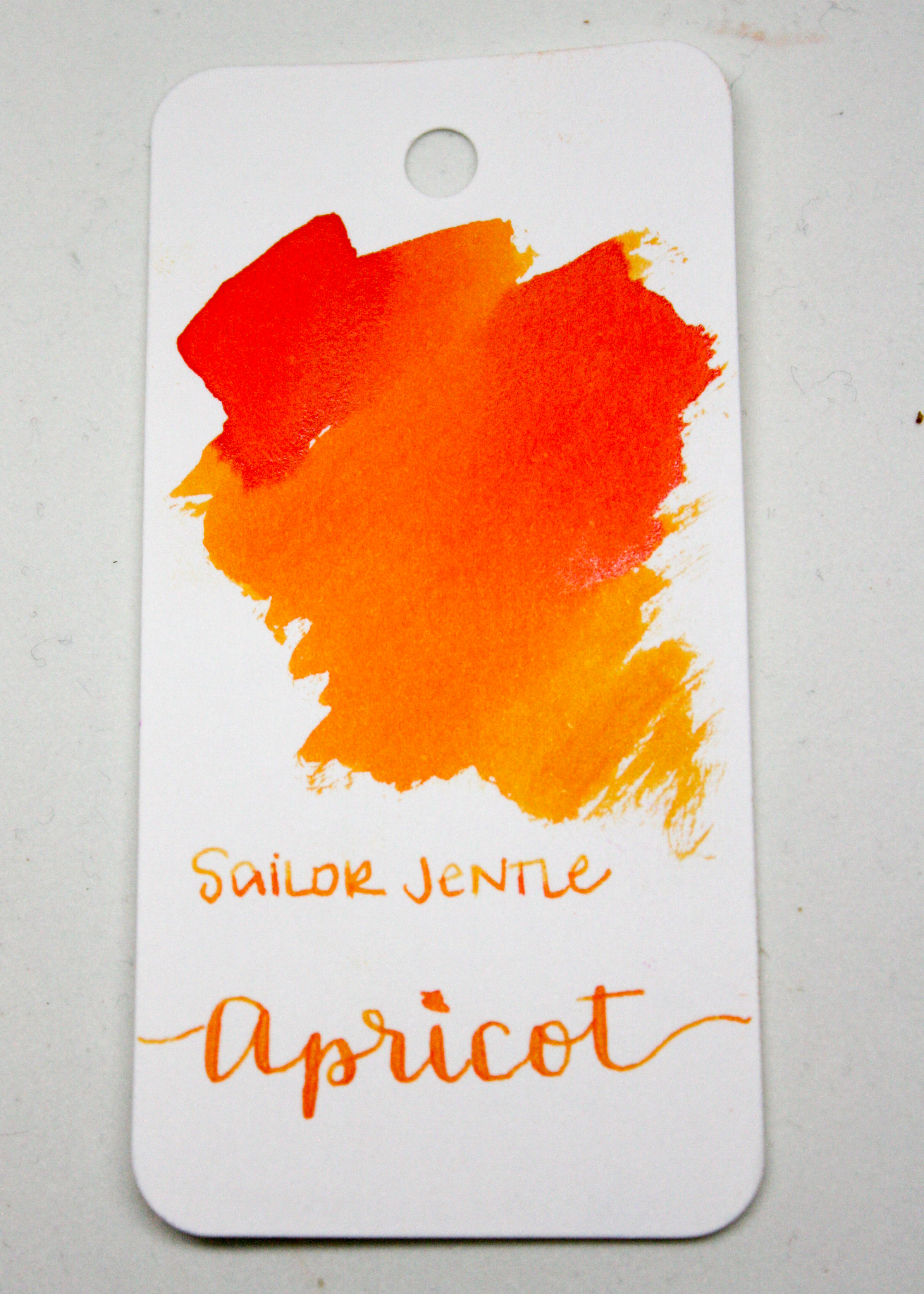 The color... - This ink is a beautiful orange, ranging from yellow orange to red orange. There is shading and a little bit of silver sheen when the ink is concentrated. Seasonally, I think this would be a summer ink.