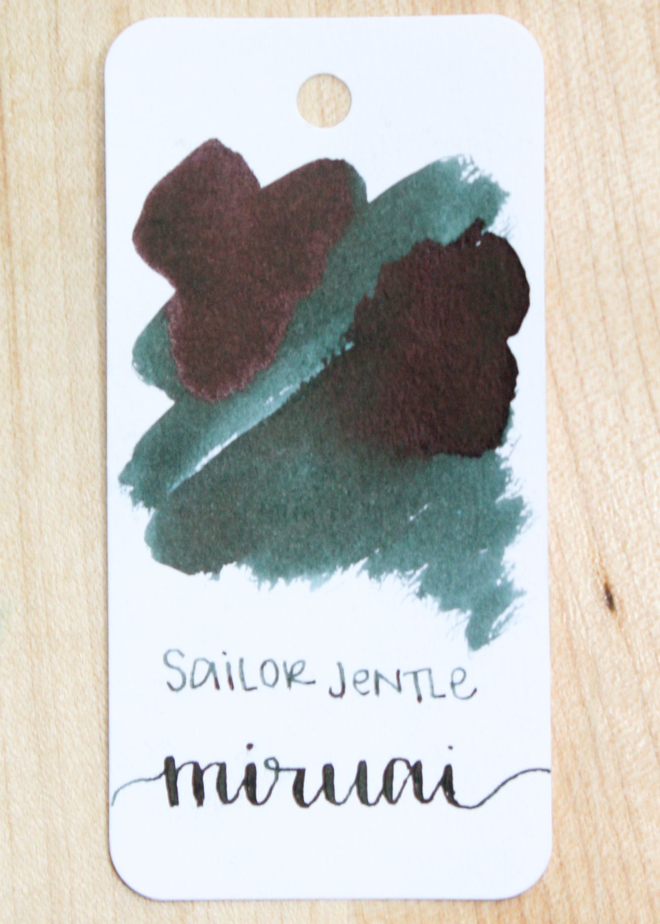 The color... - Miruai is a dark green, with a black sheen. The green is almost a teal, but not quite. Seasonally, I would use this in the winter.