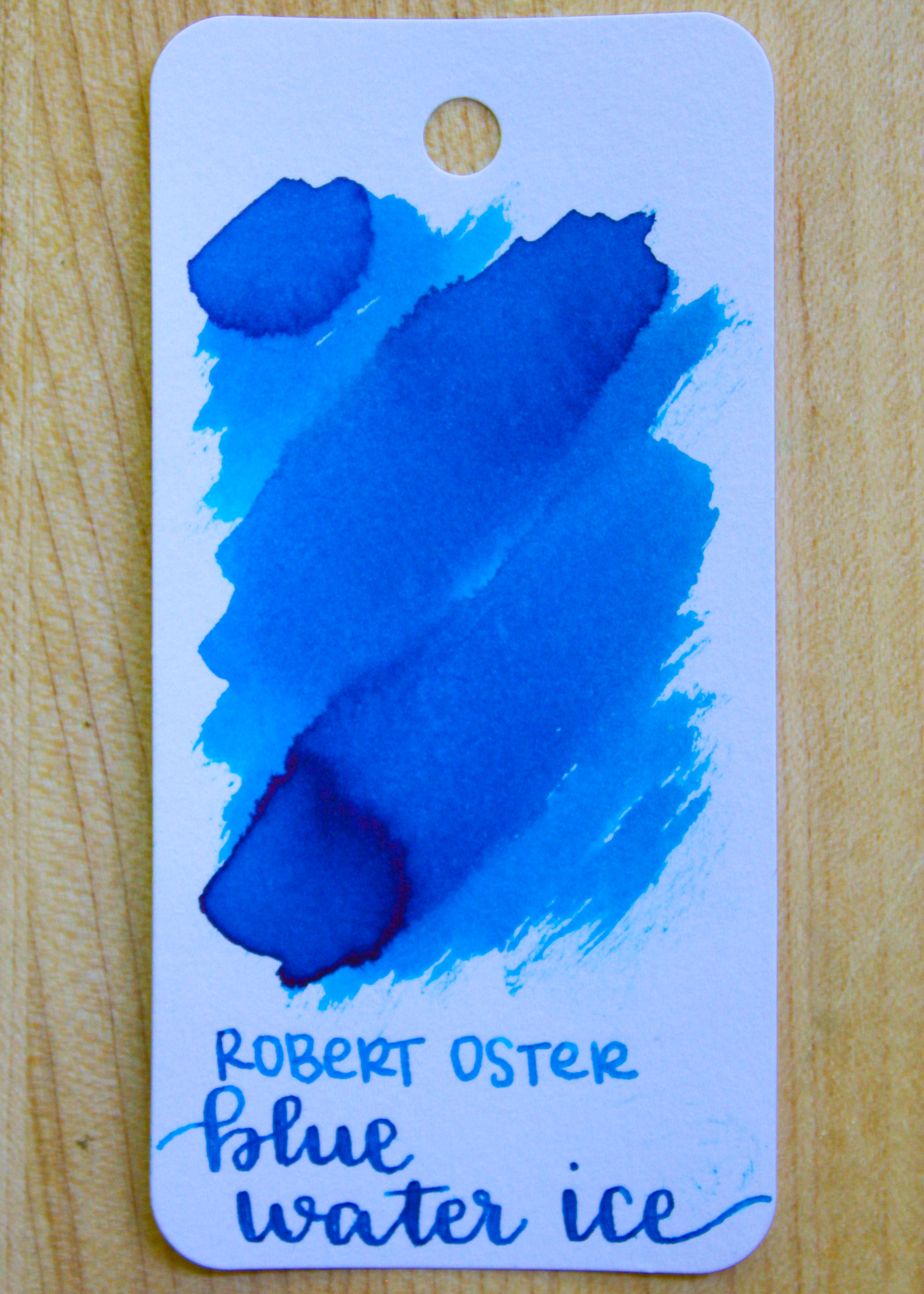 The color... - Blue Water Ice is a bright blue with pink sheen (I would call it a turquoise). Seasonally, it is a beautiful summer ink.