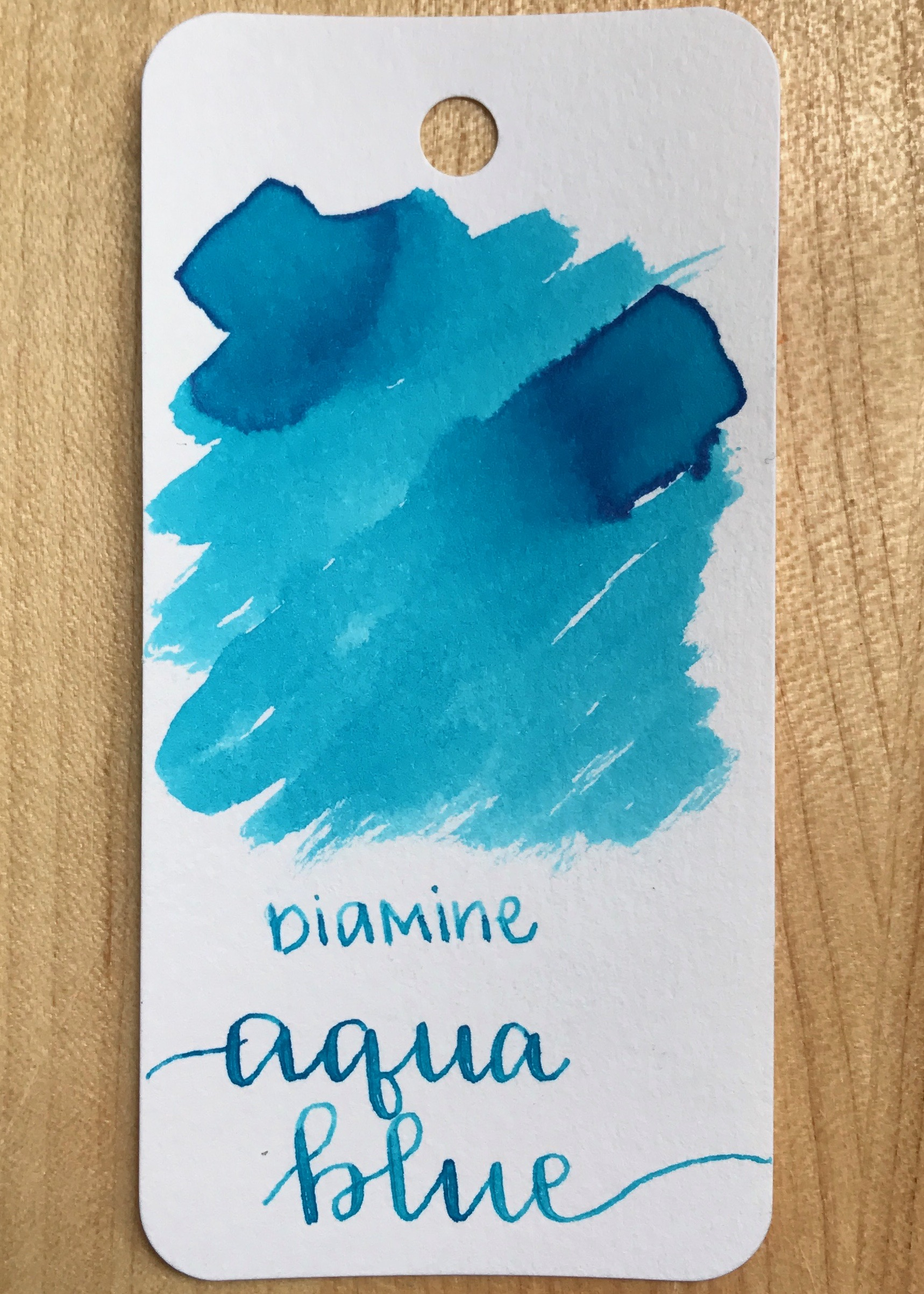 The color... - Aqua Blue is a bright turquoise blue, with the tiniest little bit of pink sheen. Seasonally, this is a summer ink.