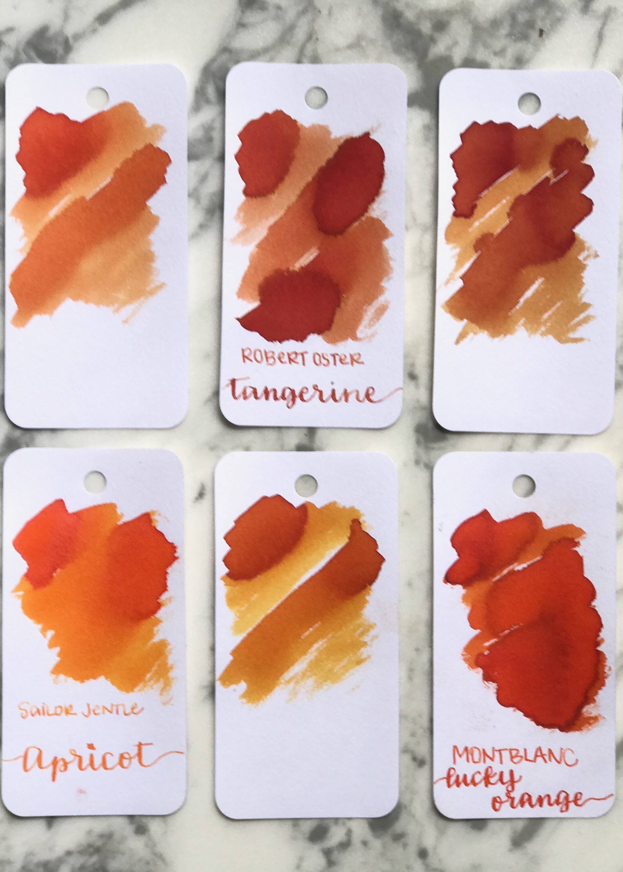 Similar inks: - Top row: left to right, Pilot Iroshizuku Yu-Yake, Robert Oster Tangerine, and Diamine Autumn Oak. Bottom row: Sailor Jentle Apricot, Robert Oster Ng Special '16 and Montblanc Lucky Orange.