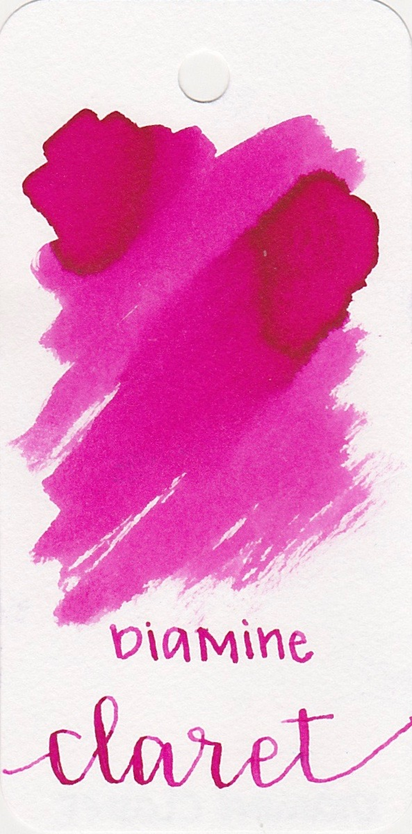 The color... - Claret is a bright pink, almost a magenta color, with a tiny bit of shading on certain papers.
