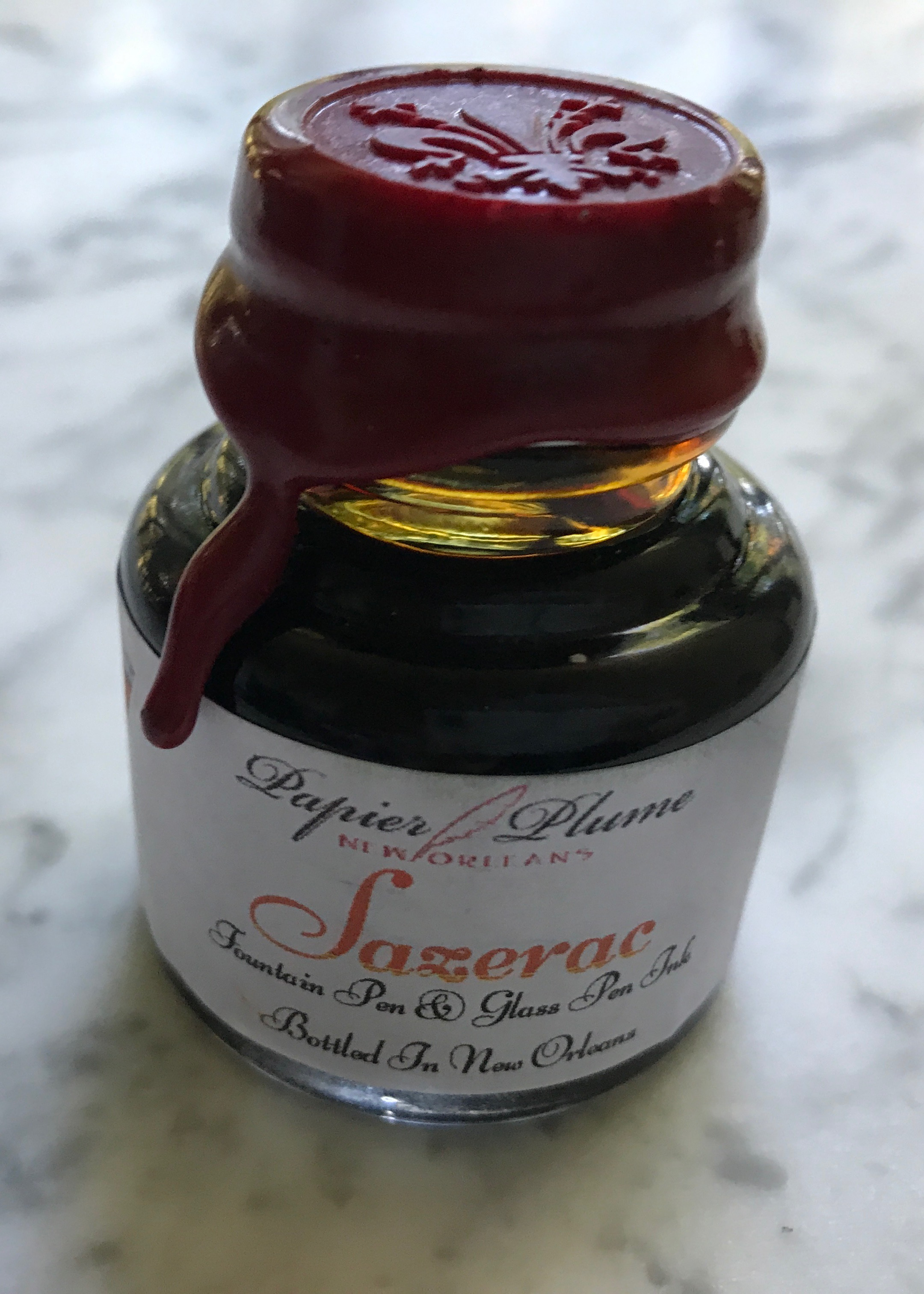 The bottle: - The bottle is glass with a metal lid, with a wax seal attached to the lid. The bottle is 30 ml of ink.