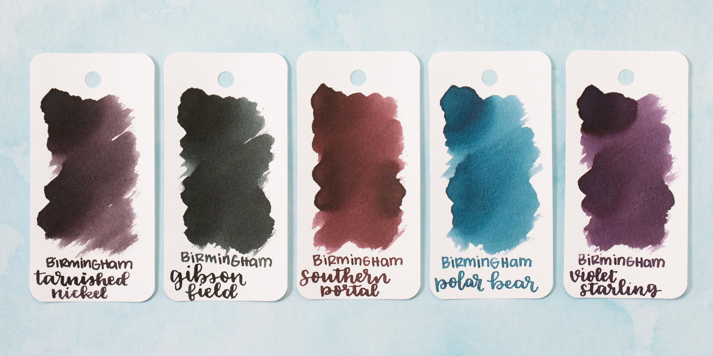 Tarnished Nickel is a dark brownish-grey, Gibson Field is a dark green, Southern Portal is a dark red, Polar Bear is a medium blue, and Violet Starling is a dark purple.