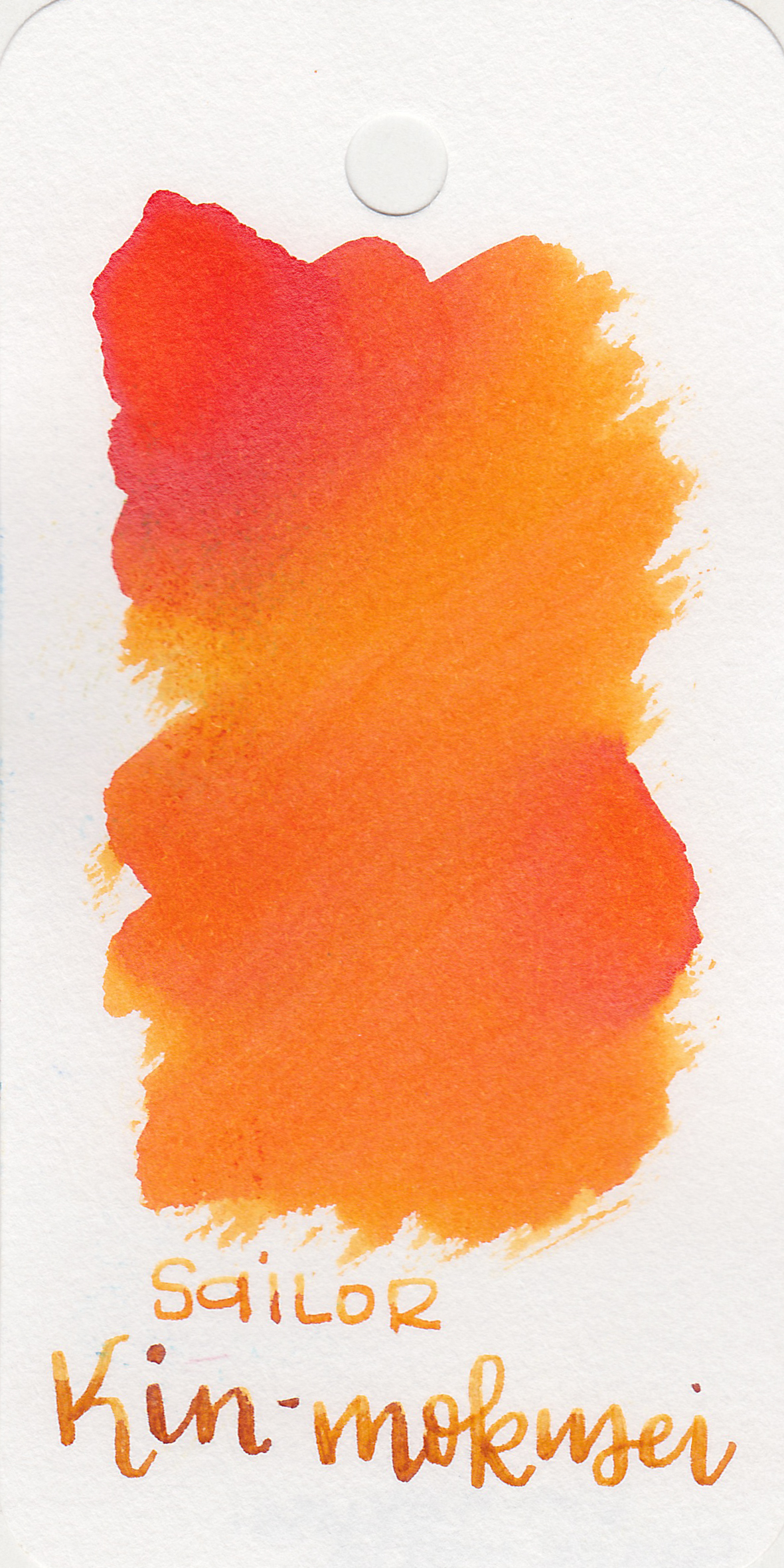 The color: - Kin-mokusei is a medium bright orange.