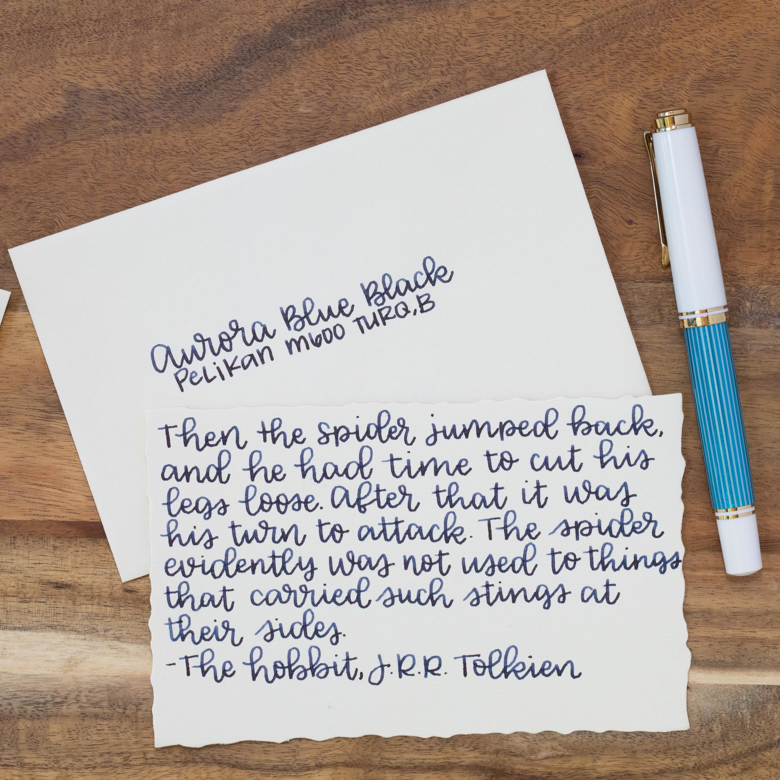 I used a broad Pelikan M600 Turquoise on G. Lalo stationery. The ink had an average flow.