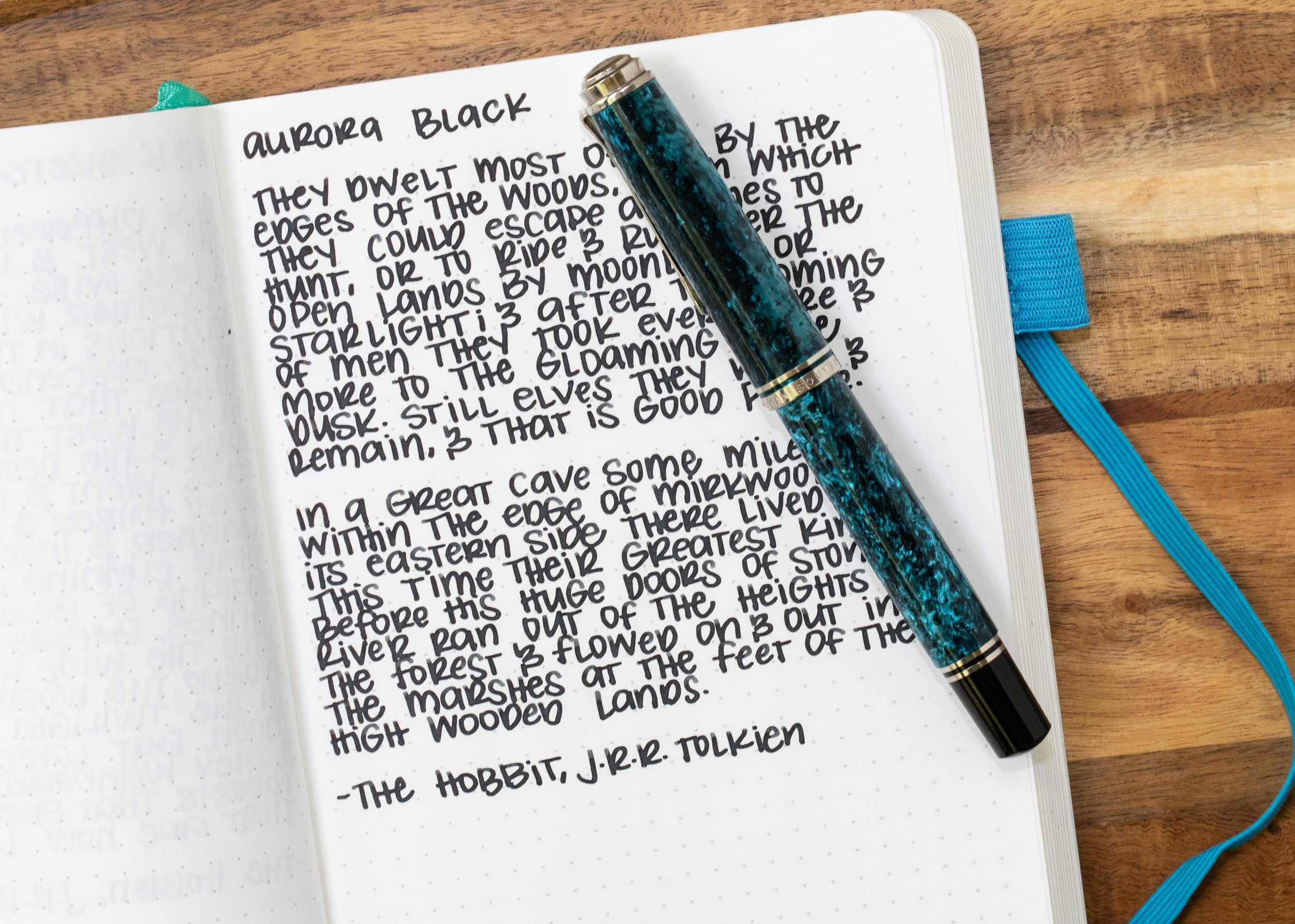I used a broad Pelikan M805 Ocean Swirl on an ivory Hippo Noto Notebook. The ink had a wet flow.