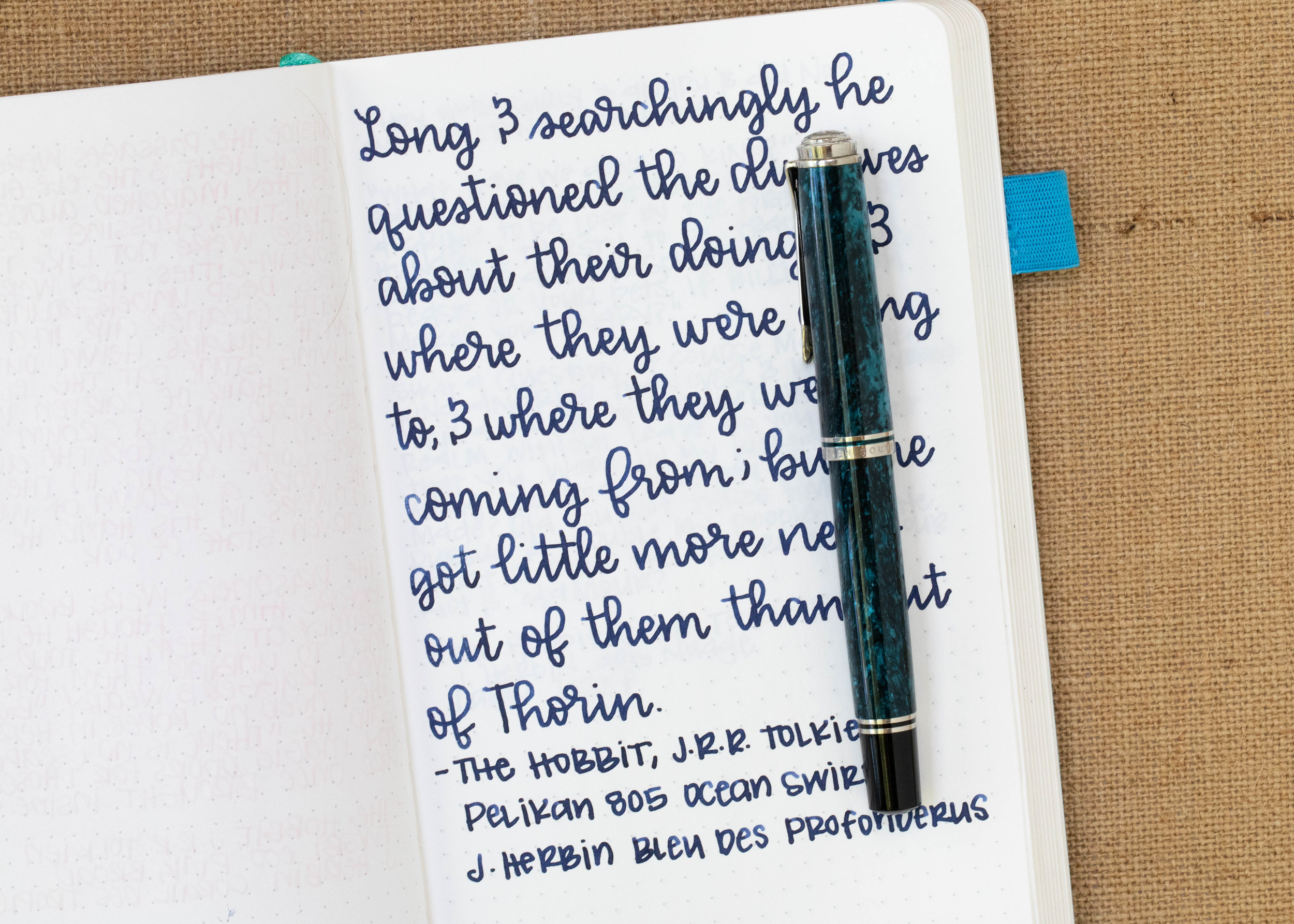 I used a broad Pelikan M805 Ocean Swirl on an ivory Hippo Noto Notebook. The ink had a nice wet flow.