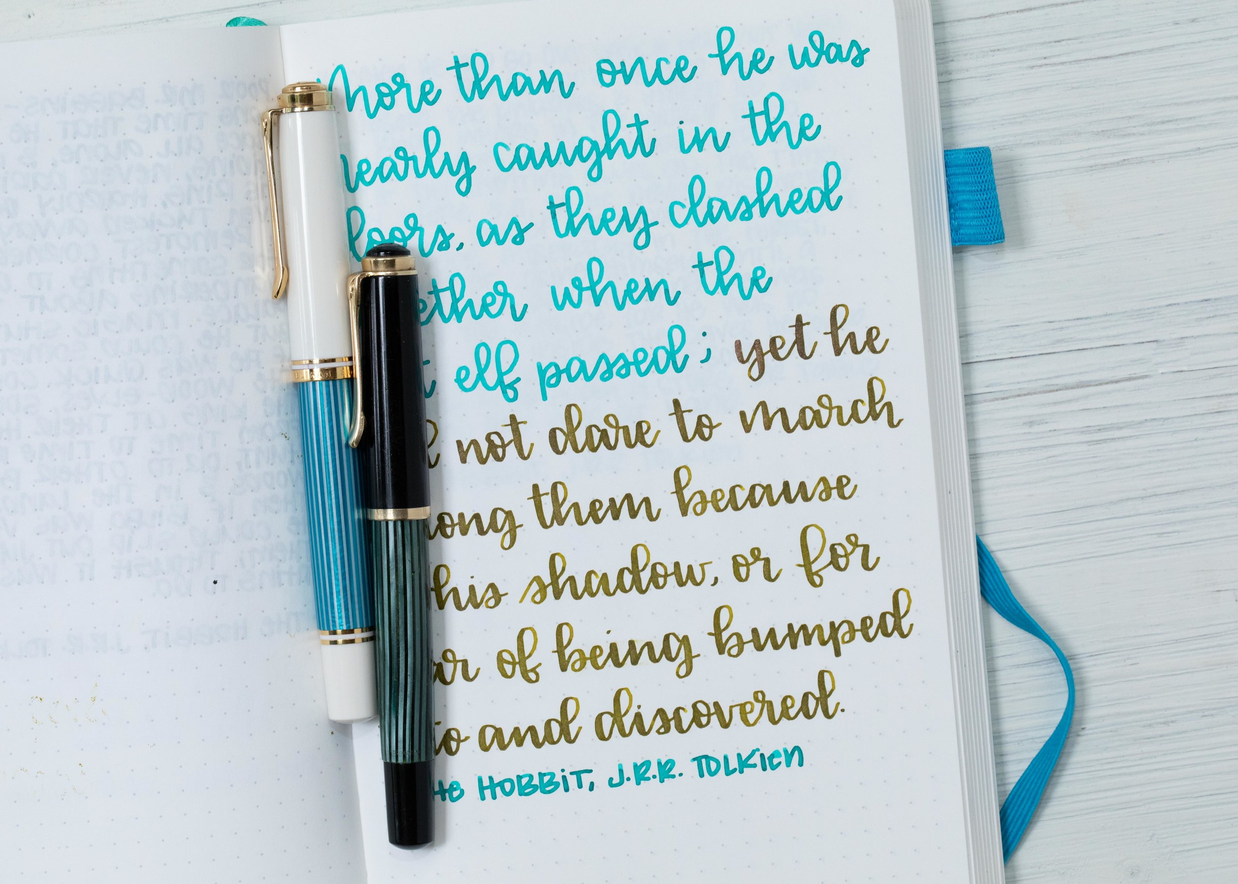 I used a broad Pelikan M600 Turquoise and a Pelikan 400N on an ivory Hippo Noto Notebook. The inks had an average flow.