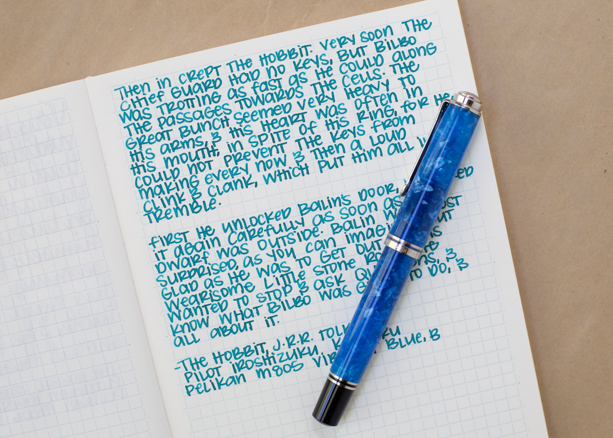 I used a broad Pelikan M805 Vibrant Blue on a Midori MD notebook. The ink had a wet flow.