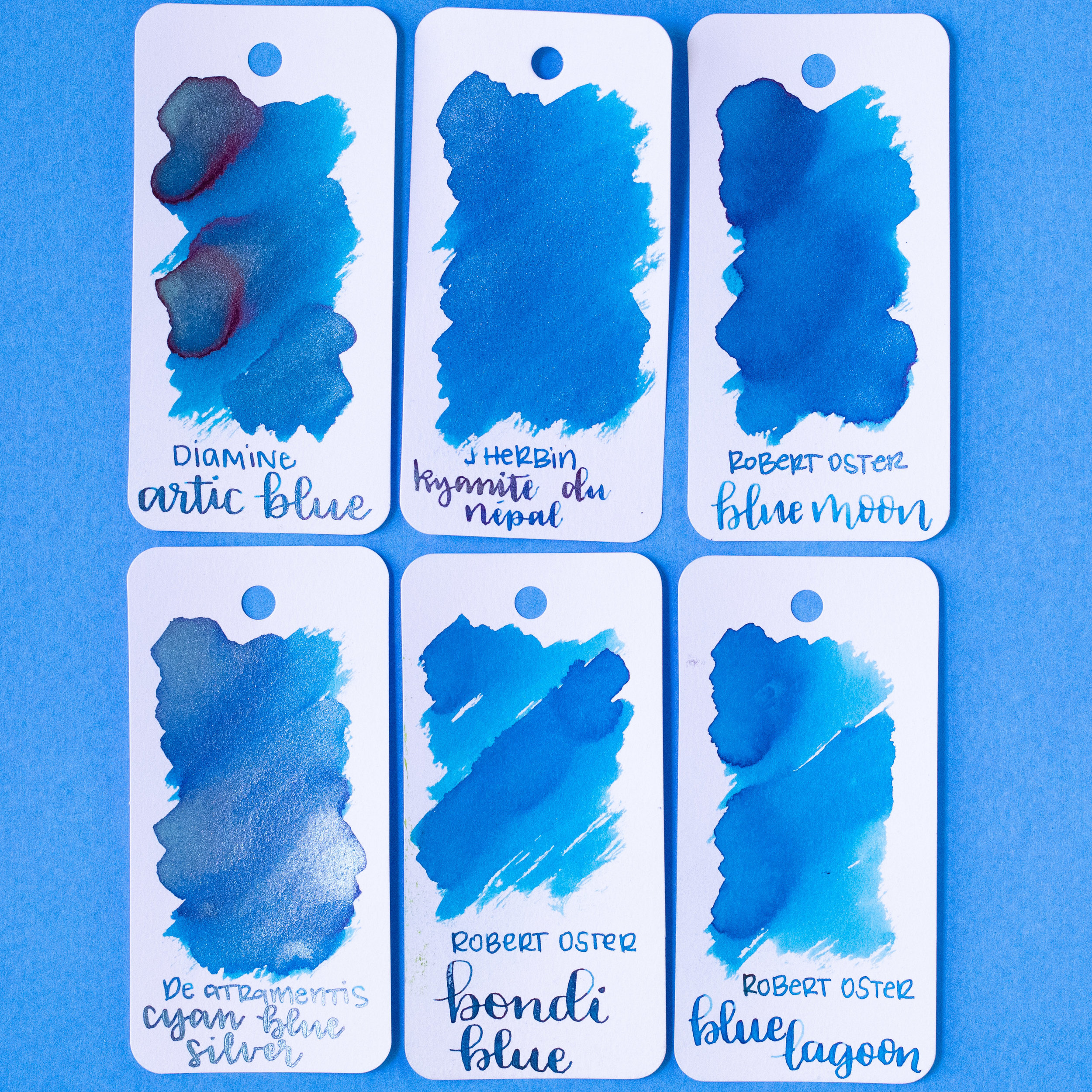 Similar inks: - Kyanite du Nepal is closest to De Atramentis Cyan Blue Silver. It's a bit brighter than Robert Oster Blue Moon, and a bit darker than Diamine Arctic Blue. Click here to see the J Herbin inks together, and click here to see the blue inks together.
