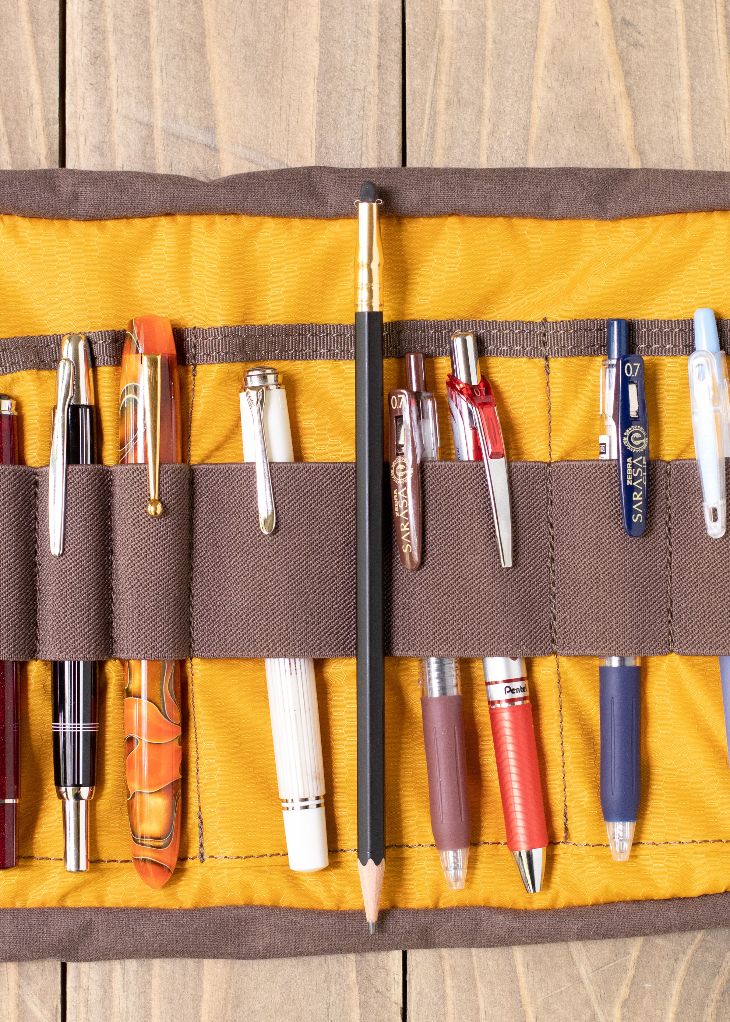 Height - The tool roll is not tall enough to hold the average pencil. Here you can see how it measures against a fresh blackwing.