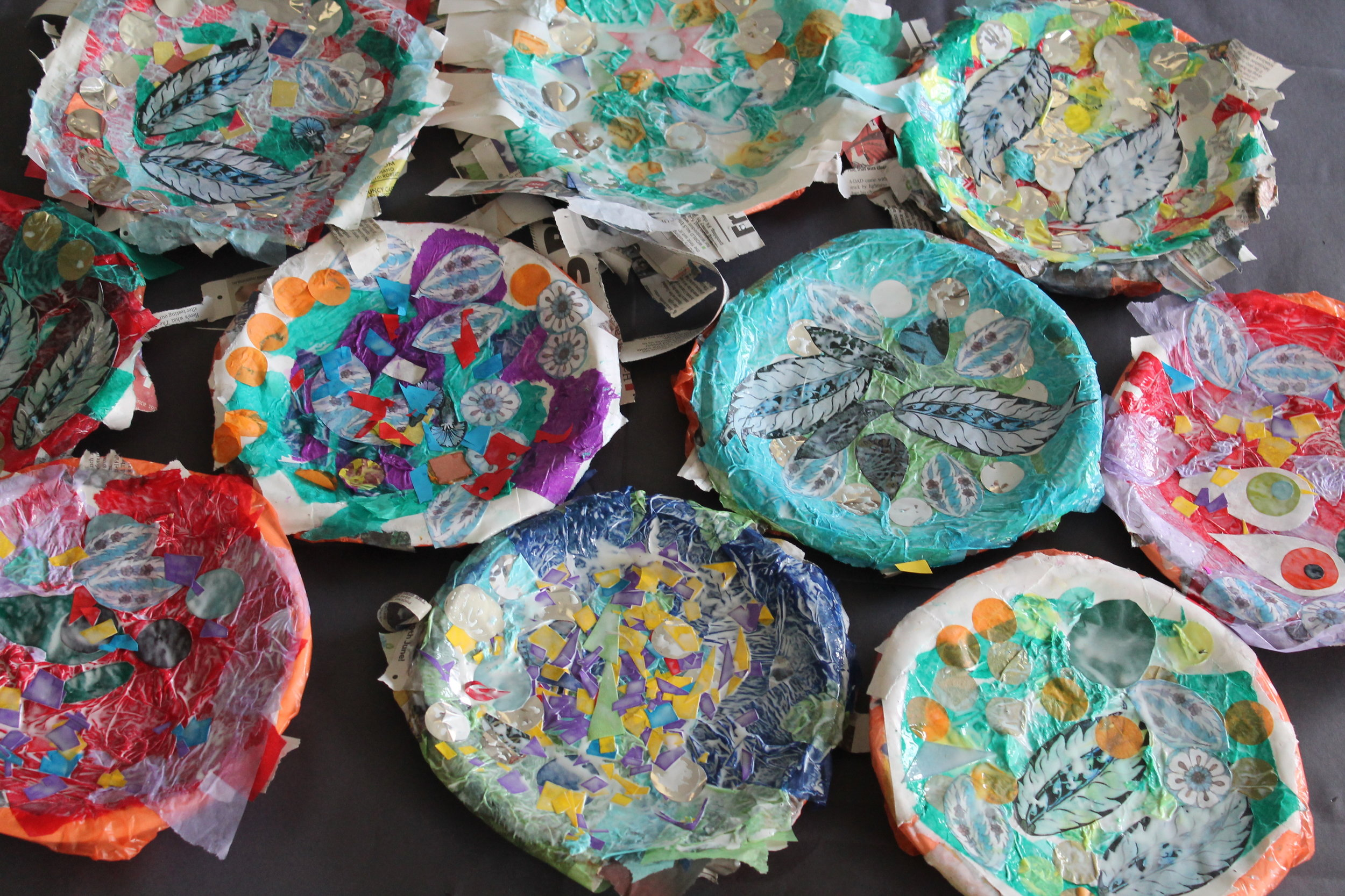 Patterned plates - William De Morgan Persian influenced colours paper mached into a plate.