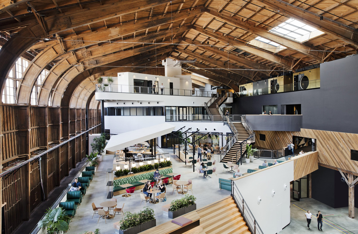 Google transformed the 1940s-era wooden hangar that once housed pioneer aviator Howard Hughes' Spruce Goose airplane into high-tech creative offices and YouTube sound stages in West L.A.'s Playa Vista. (Google images by Connie Zhou)