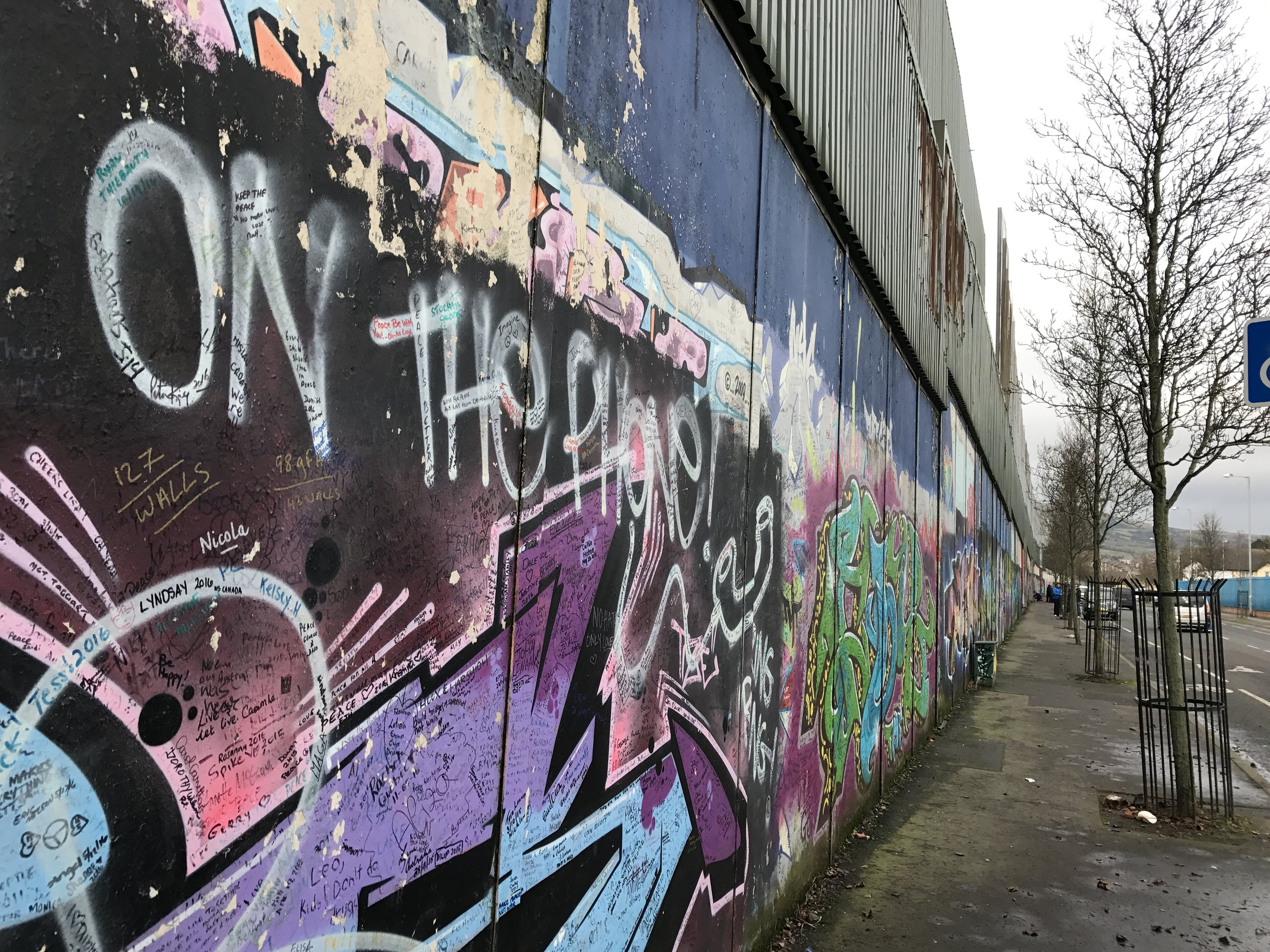 A peace wall in Belfast, diving neighborhoods to reduce violence.