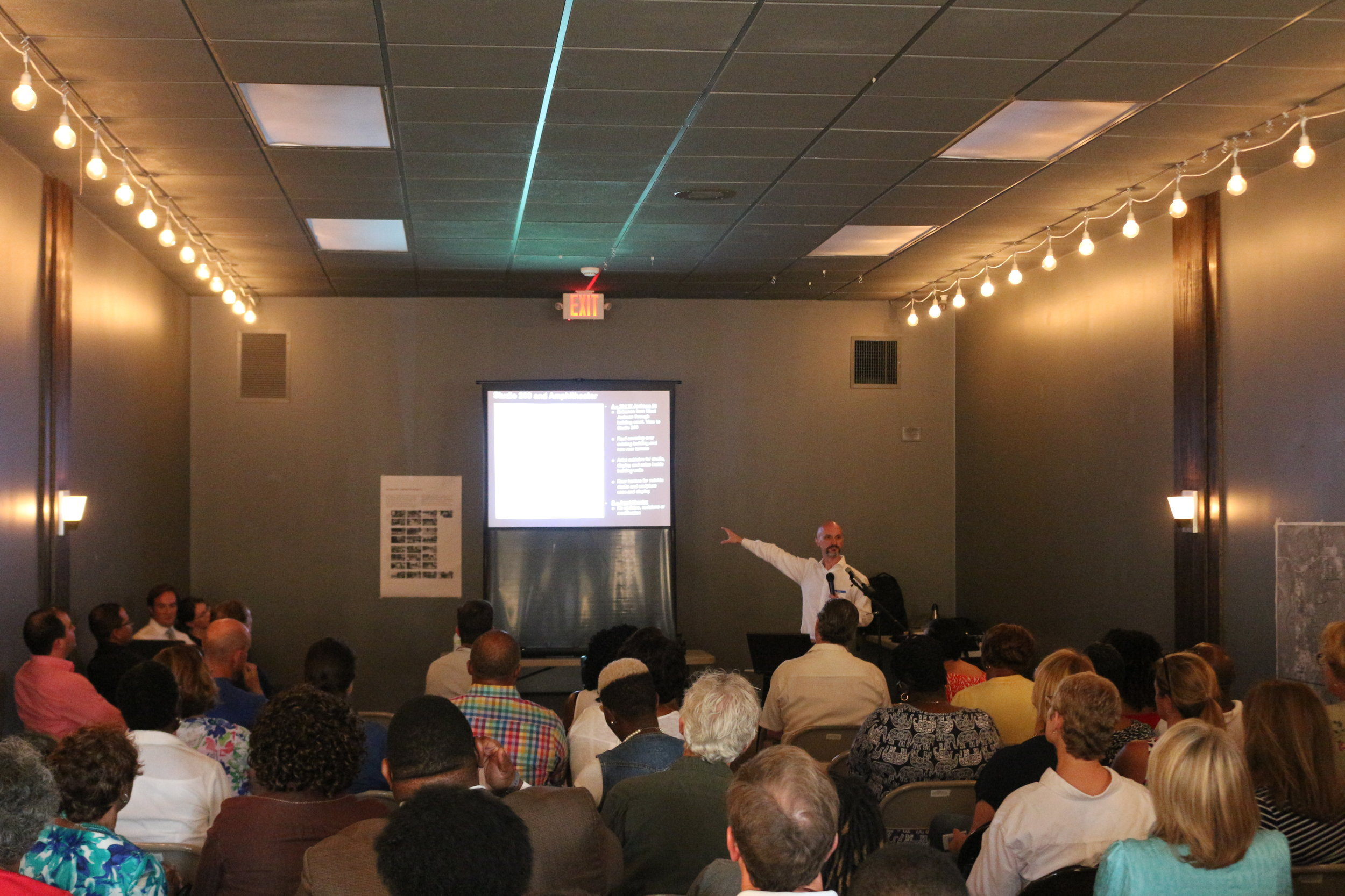 The consultant team presented subjects such as economic opportunity at the Work in Progress presentation.