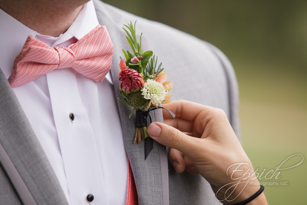 boutonniere with dahlia buds, scabiosa, and maple samara