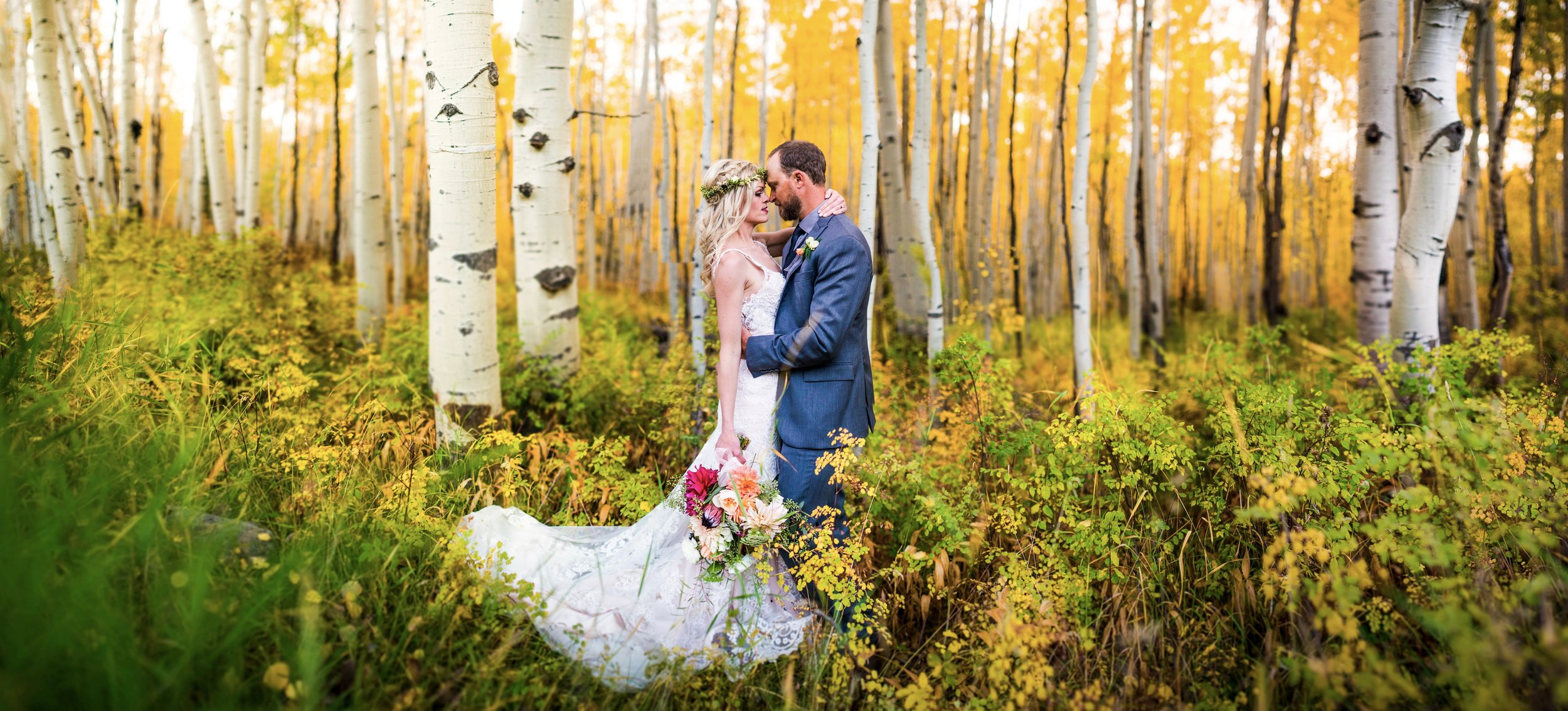 Bride and groom in aspen grove