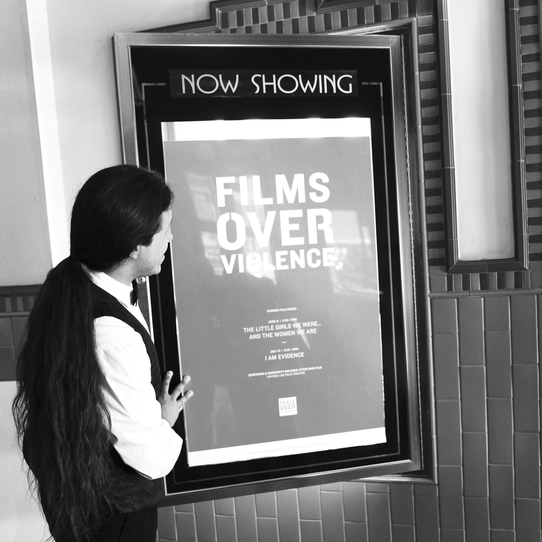 "Los Feliz 3 Theater staff showcases POV's first ""Films Over Violence"" screening poster."
