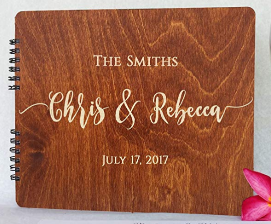 Custom Photo Album: $135 - This photo album allows guests to write you a special note alongside their photo strips. The book is a huge hit and a classy keepsake. Choose between four different wood stains: oak, burnt cocoa, mahogany and black.