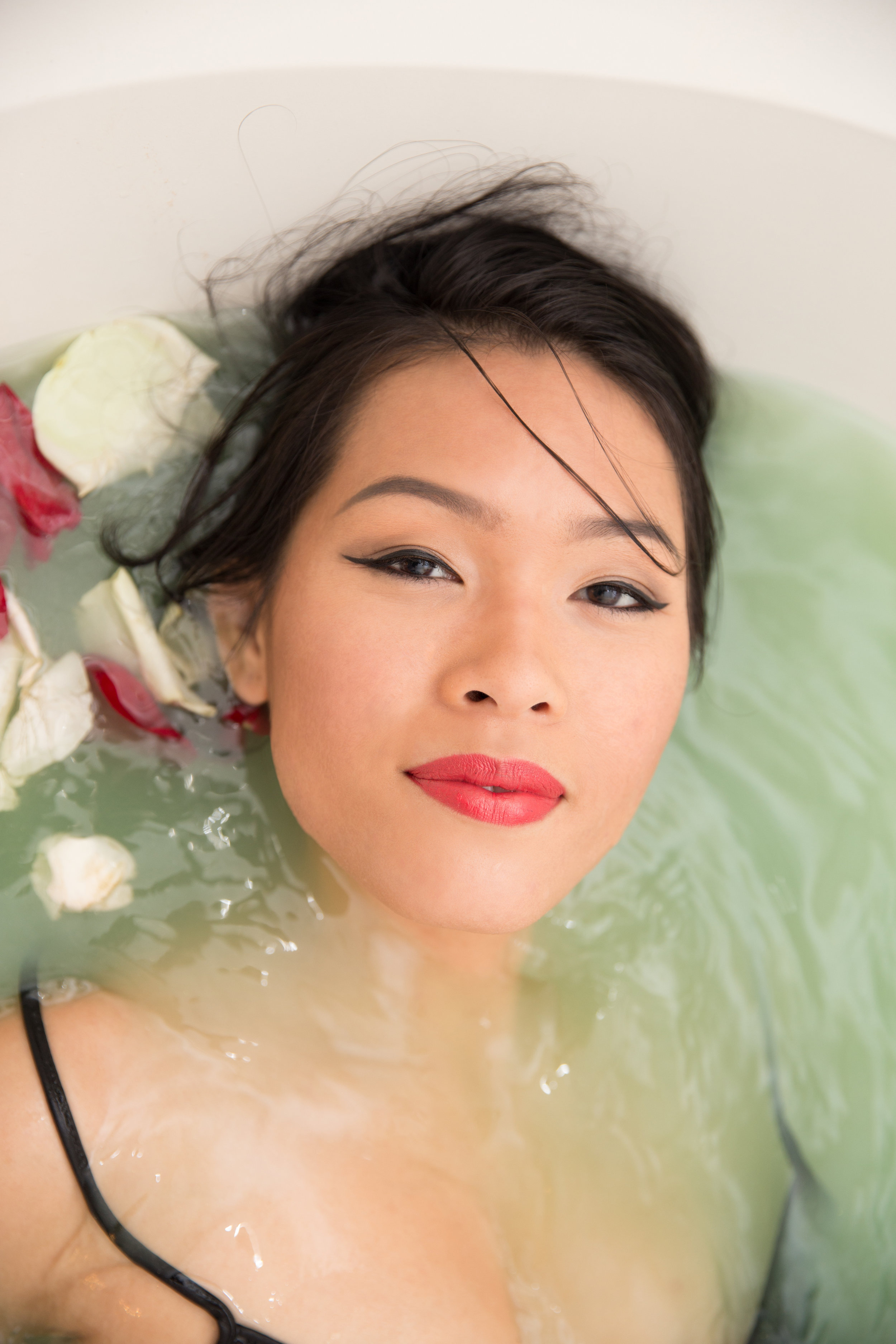 teal bath with rose petals