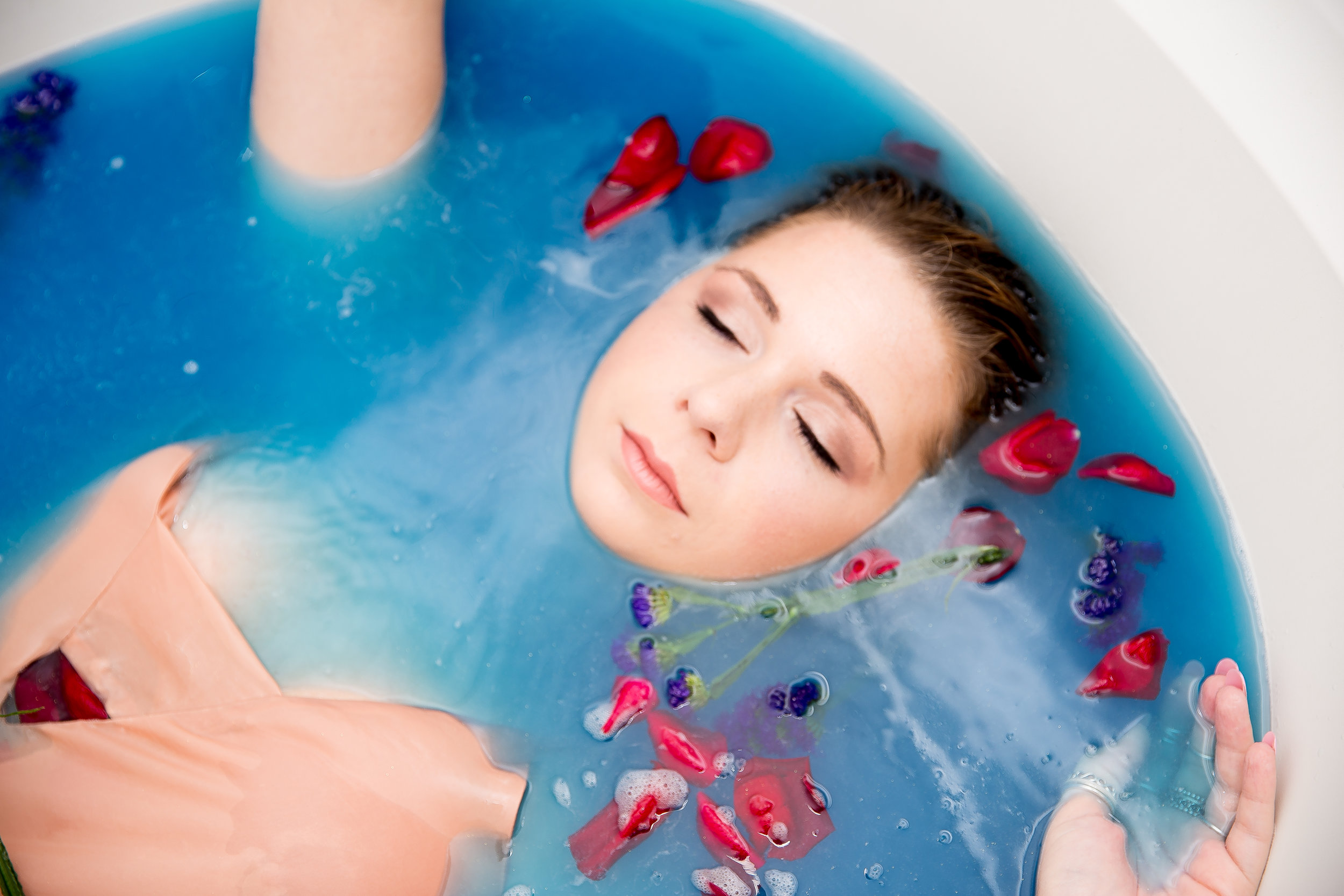 blue bath closeup with rose petals