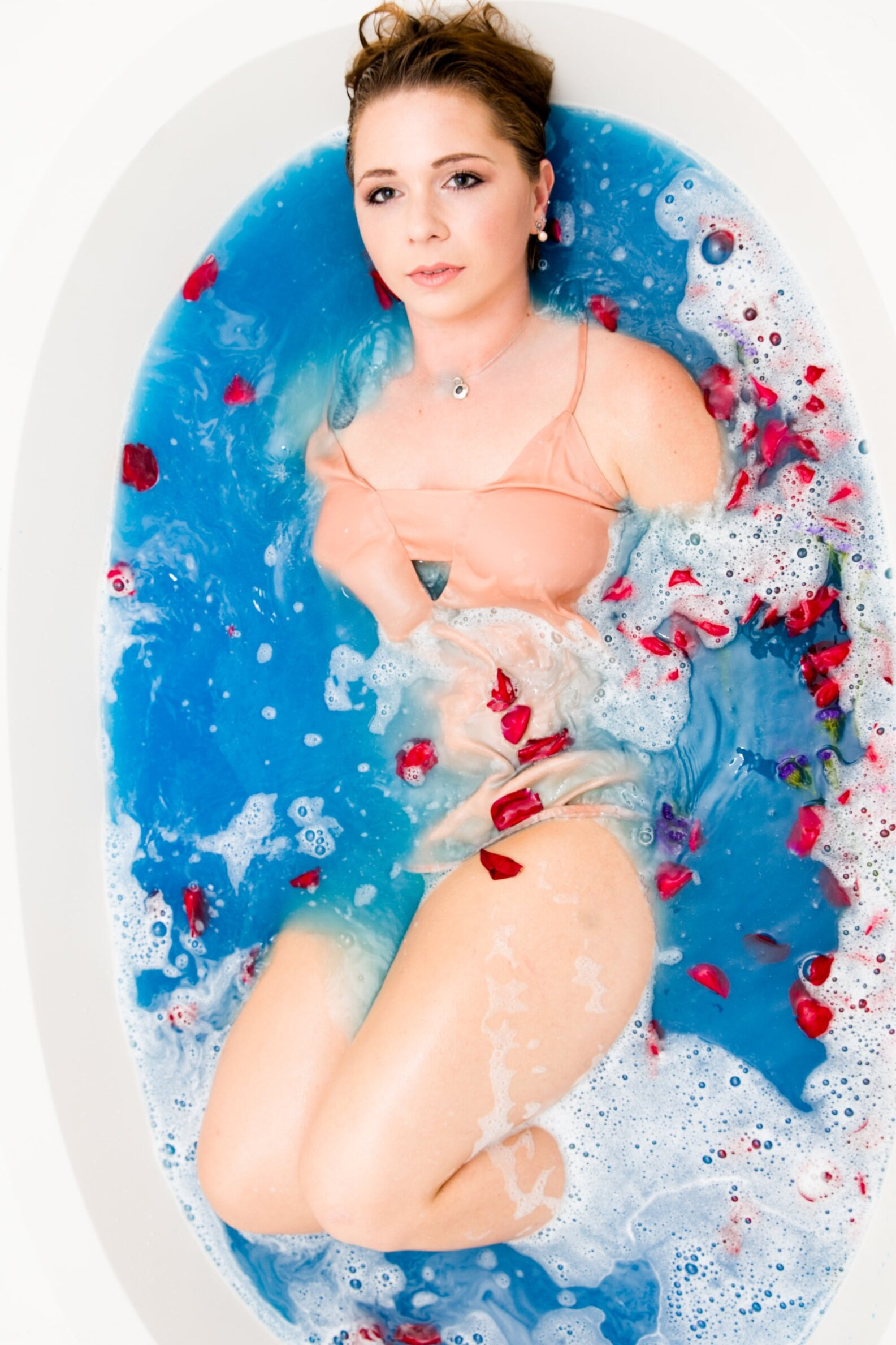 blue bath with red rose petals