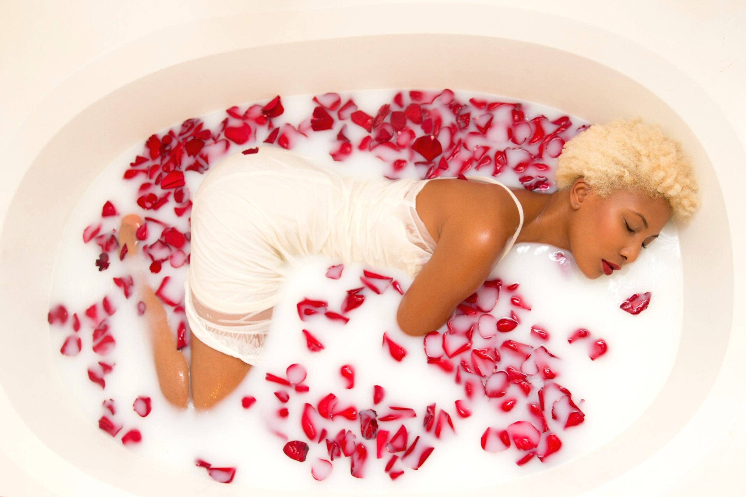 rose petal milk bath submersion