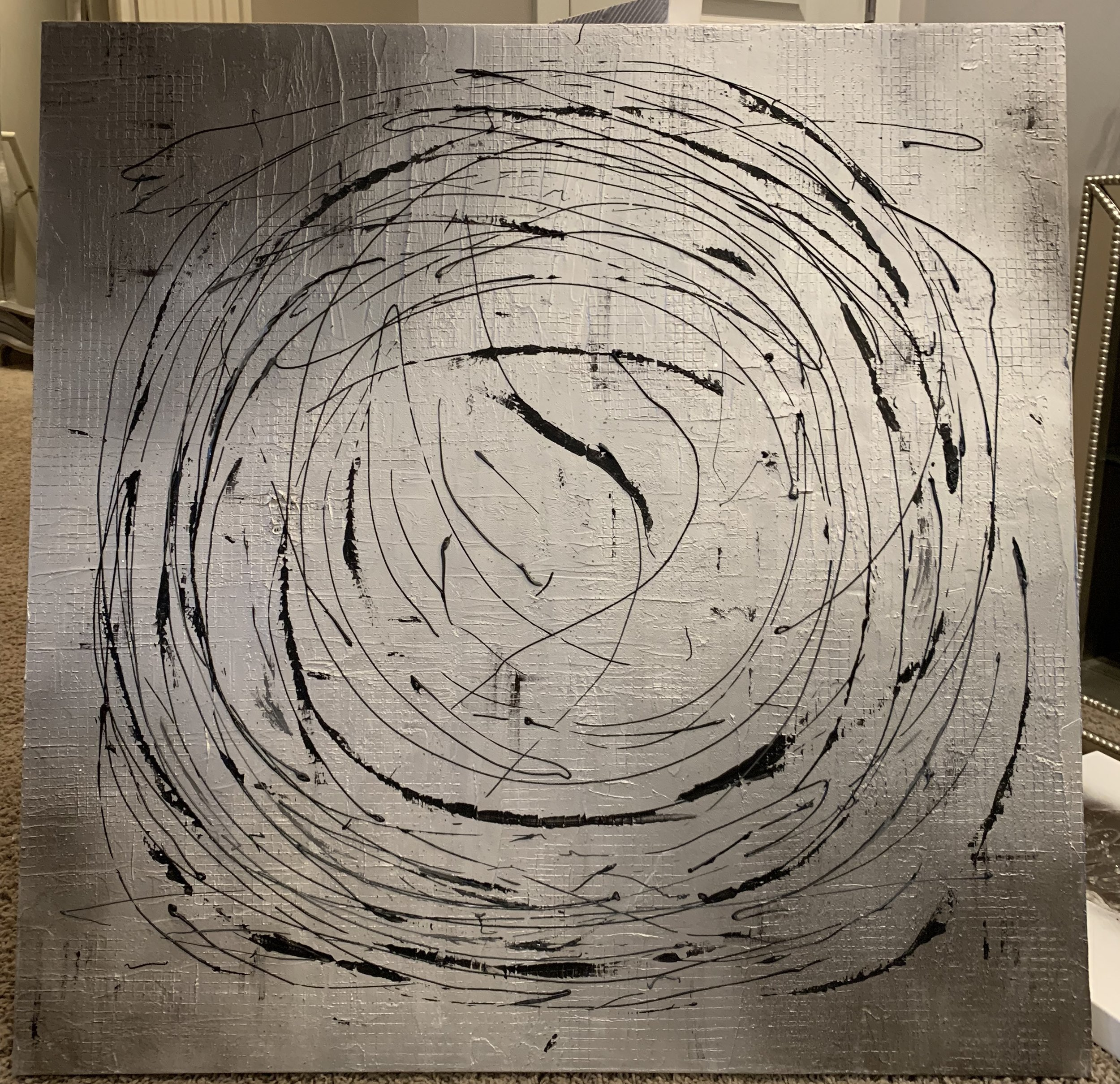 'Dynamic' is just that. you can't see it very well here but the texture behind the swirl is stamped with a grid like design. this is shown as a 36x36. want a different look? Hang it on the diagonal!