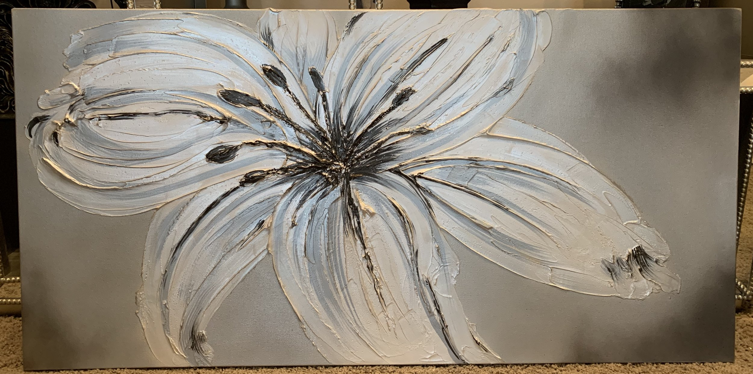 'Lily' is shown as a 24x48 and can be hung vertically as well. 'Lily' has a molted background and has lots of sparkle and glass in the center.
