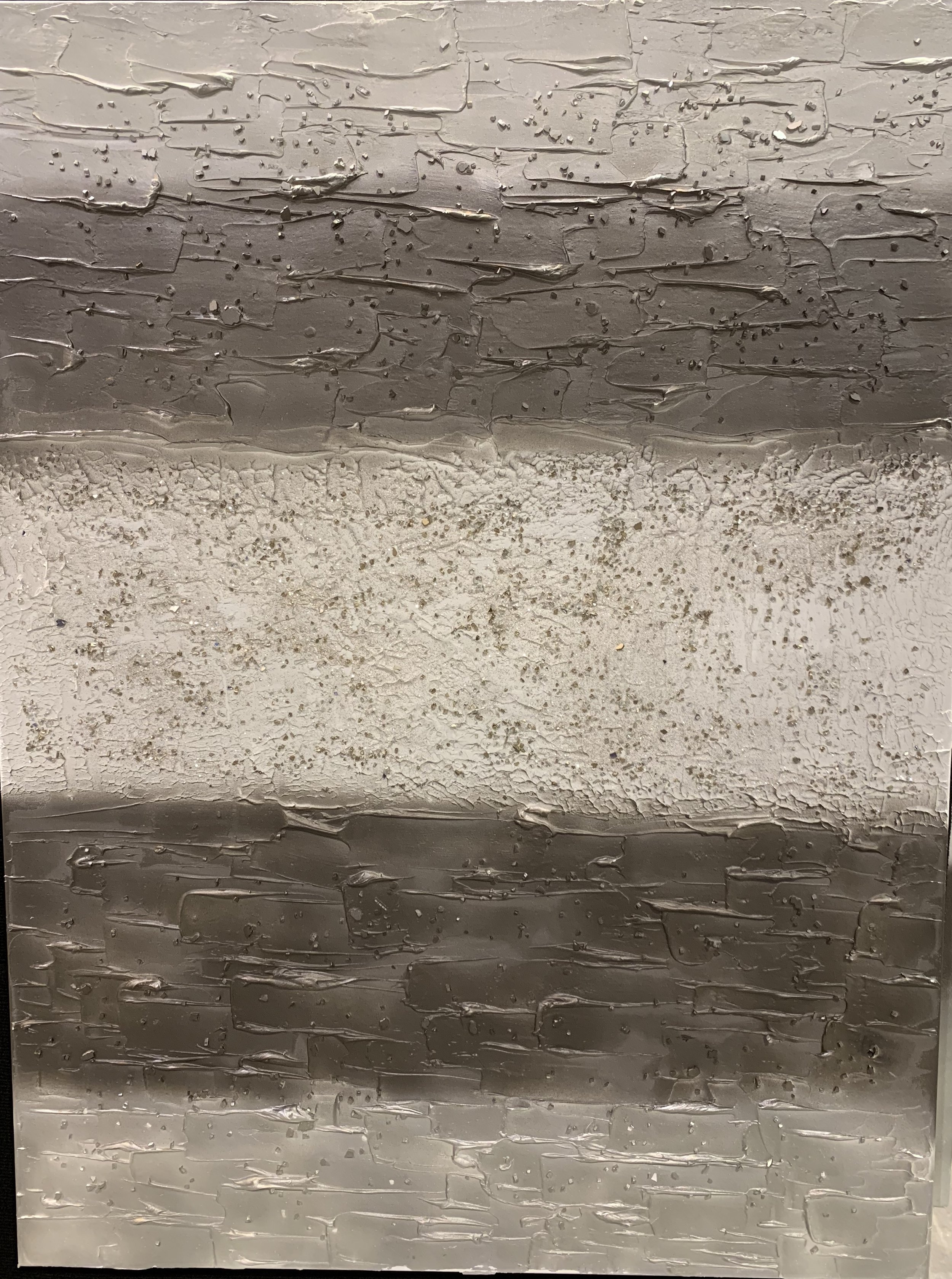 'Layers' has lots of texture and stone. the center layer is diamond white with gold glass. that layer is flanked by a bronze gray with silver layers on the end. this is shown as a 36x48.