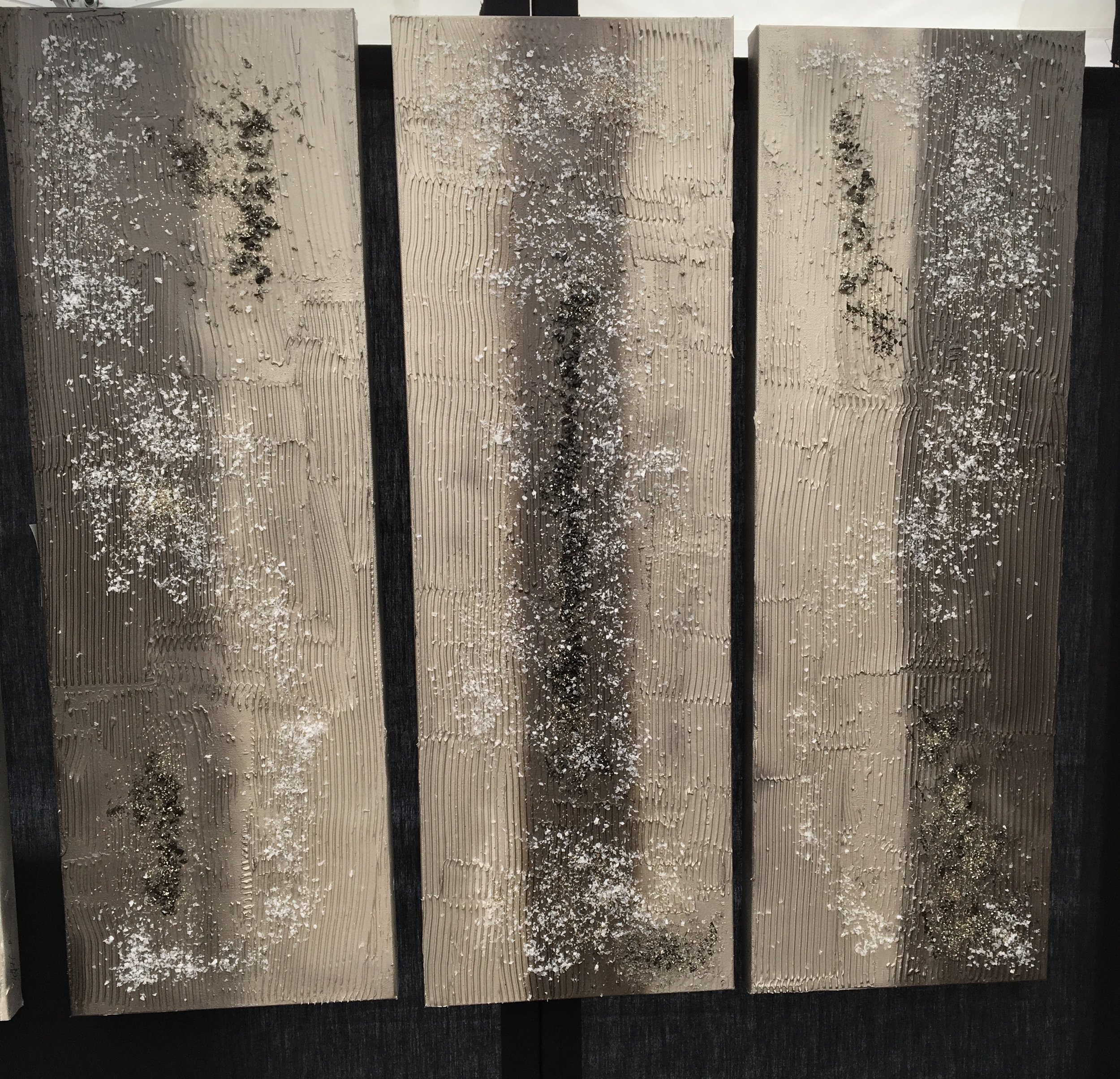'Pilars' are three 16x40 panels that obviously make a statement. the white crystals that you see are lighter and have an airy feel against the silver and grey tones with black accents.