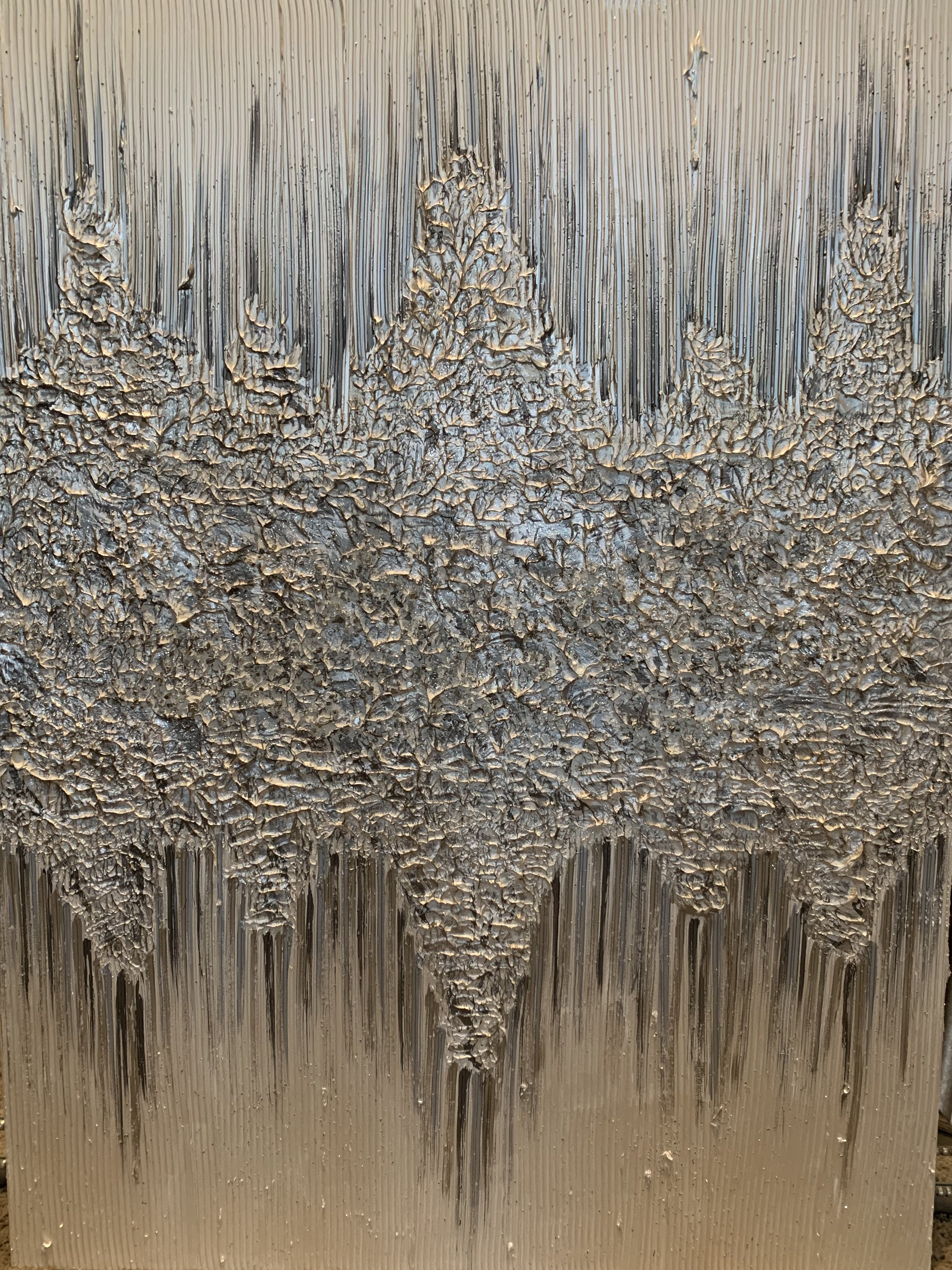 Lots of texture in the middle with stones in bronze, silver, champagne and grey spilling onto a diamond white background. 36x48 as shown.