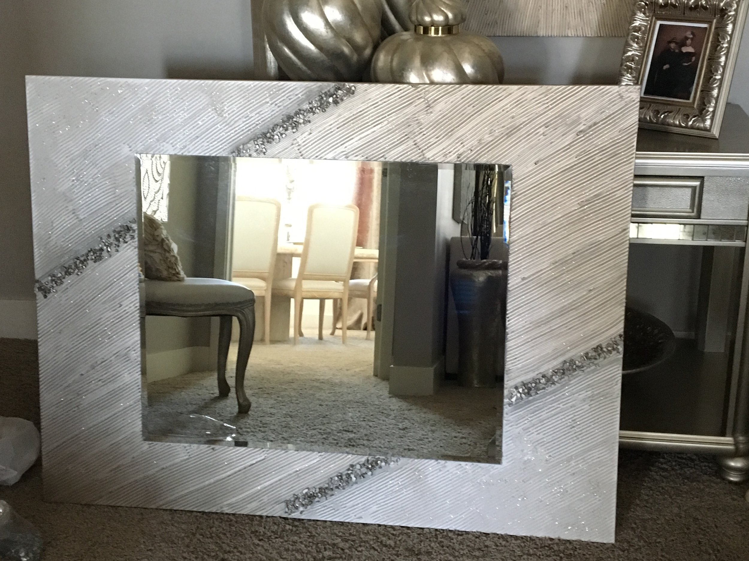 'Starlight Mirror' is shown in a 36x48 with a beveled mirror surrounded by texture. This can be hung either way. Perfect for a bathroom or entry.