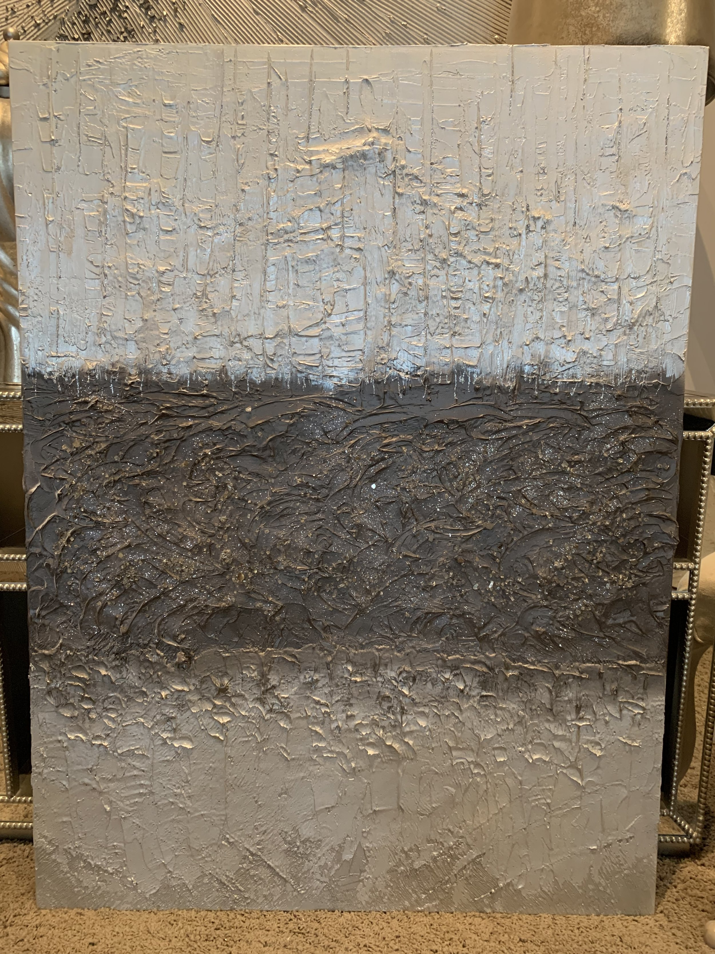 'Mastering' is a 36x48 dramatic piece in diamond white falling into bronze layers  falling into silver tones.