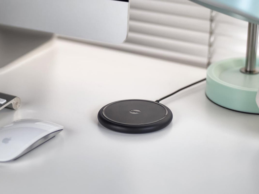 Mophie Wireless Charger - Charge your phone wirelessly with the Mophie wireless charger.