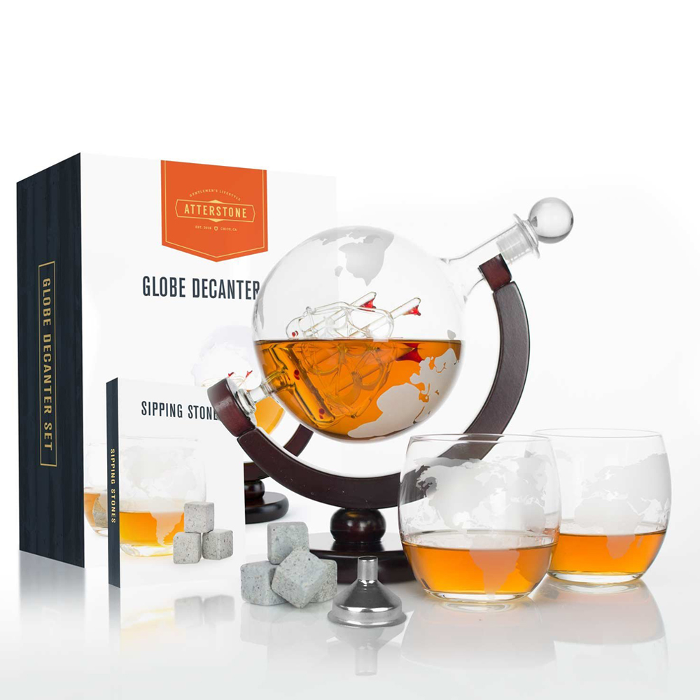 Globe Atterstone Whiskey Decanter - Spin your tipple around the world with the Globe Attersone Whiskey Decanter. This is the perfect gift for your travel buddy or globetrotter companion. The glass rest on a wooden mahogany stained stand. Twirl the globe while releasing the natural aromas of your whiskey to experience the taste to a whole new level. The decanter comes with 2 globe glasses, a carrying bag, 9 whiskey stones, and an easy pour funnel. It can store up to 850ml.