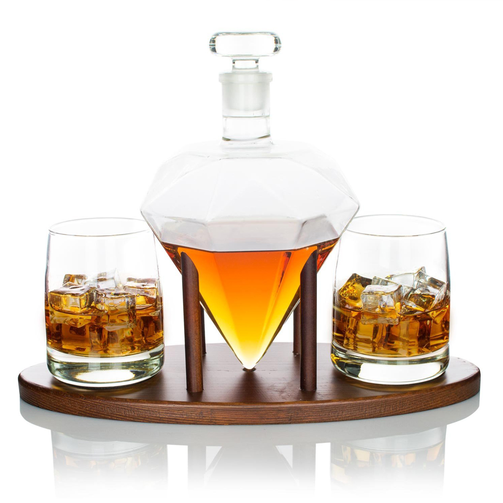 Atterstone Diamond Decanter Set - Catch everyone's eye in the party with the stylish Atterstone Diamond Decanter Set. The unique diamond-shaped liquid holder is made up of borosilicate glass that rests on a mahogany stand handcrafted by master carpenters. The Diamond Decanter comes with two diamond scotch glass.It looks smaller than you think the glass can hold up to 1000ml of your beloved liquid.