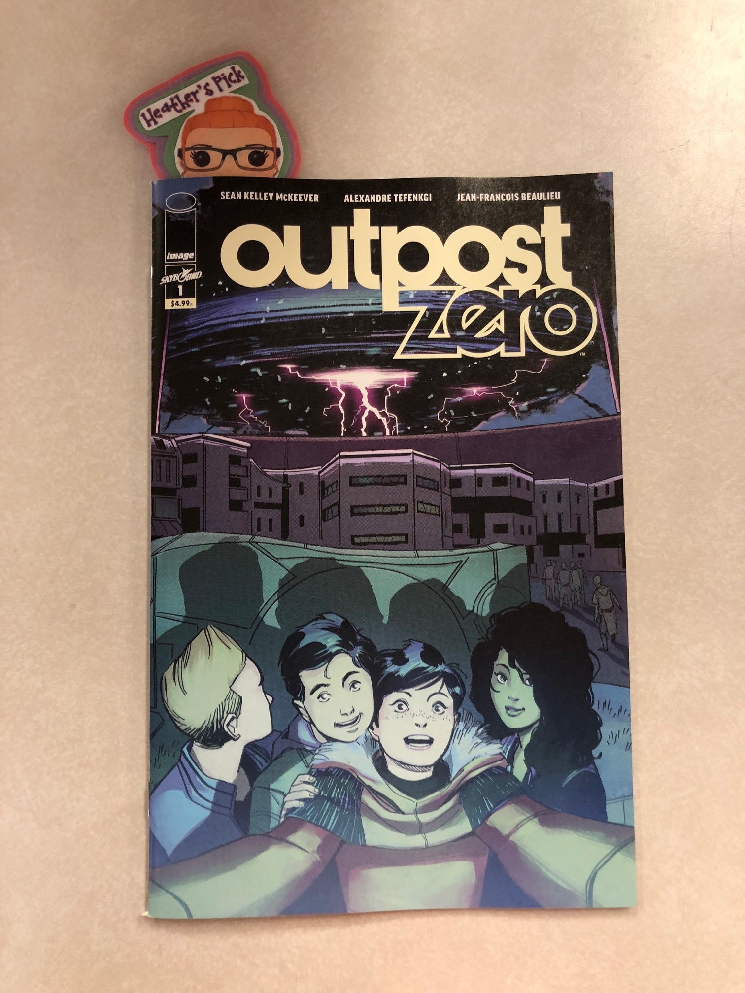 Outpost Zero #1 - Heather's PickWriter: Sean Kelley McKeeverArtist: Alexandre TefenkgiColorist: Jean-Francois BeaulieuWelcome to Outpost Zero, the smallest town in the universe. The people there work the land, go to the fights every Friday night, and tuck their children into bed-but the Outpost is no place for dreams or aspirations. To survive is ambitious enough. As Alea and her friends graduate to adulthood on a frozen world never meant to support human life, something stirs. Something sees... Explore the mysteries and wonder of the Frost in this oversized debut issue by Eisner-winning writer Sean Kelley McKeever (Mystique), artist Alexandre Tefenkgi, and colorist Jean-Francois Beaulieu (I Hate Fairyland).